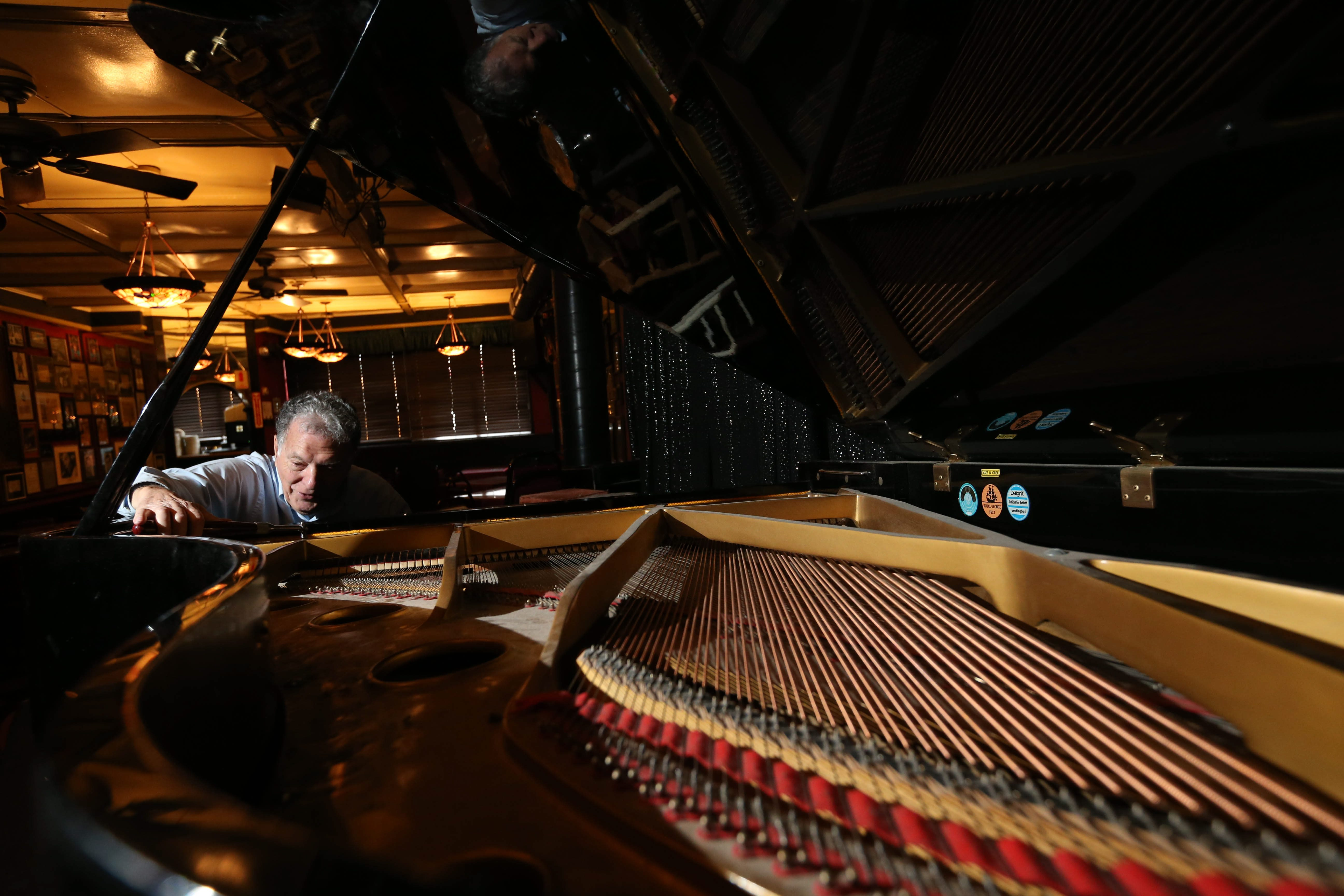 Vinny Tagliarino tunes the piano at the Anchor Bar in Buffalo earlier this month. The blind piano technician has been tuning the restaurant's piano since 1960.