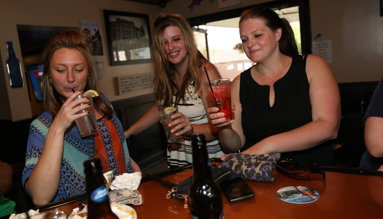 Ann Marie Damon, left, Kristen Auer and her sister Becky Auer enjoy some libations at the Press Box on Abbott Road in Lackawanna. To view a photo gallery, visit buffalonews.com.