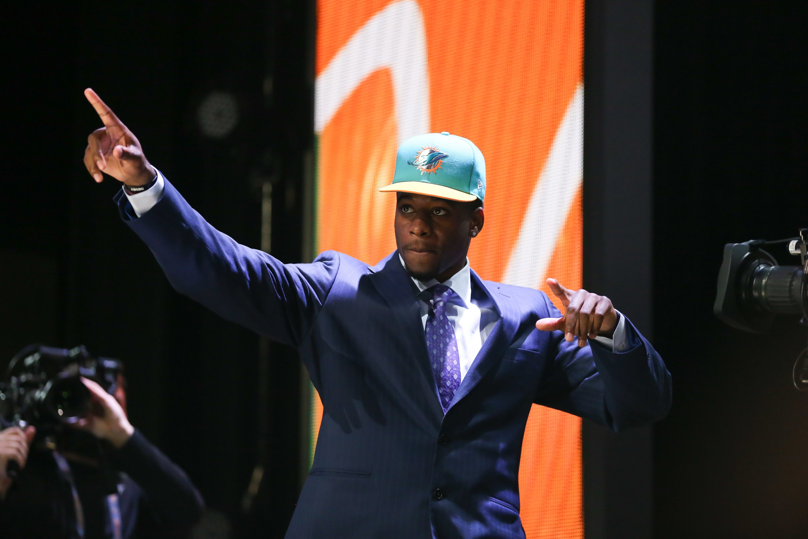 CHICAGO, IL - APRIL 30:  DeVante Parker of the Louisville Cardinals walks on stage after being picked #14 overall by the Miami Dolphins during the first round of the 2015 NFL Draft at the Auditorium Theatre of Roosevelt University on April 30, 2015 in Chicago, Illinois.  (Photo by Jonathan Daniel/Getty Images)