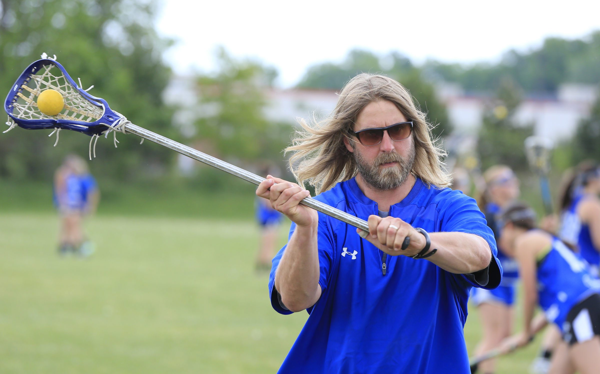 Frontier girls lacrosse coach Tim Myslinski hasn't cut his hair in three years and won't until the Falcons win a Class A title.