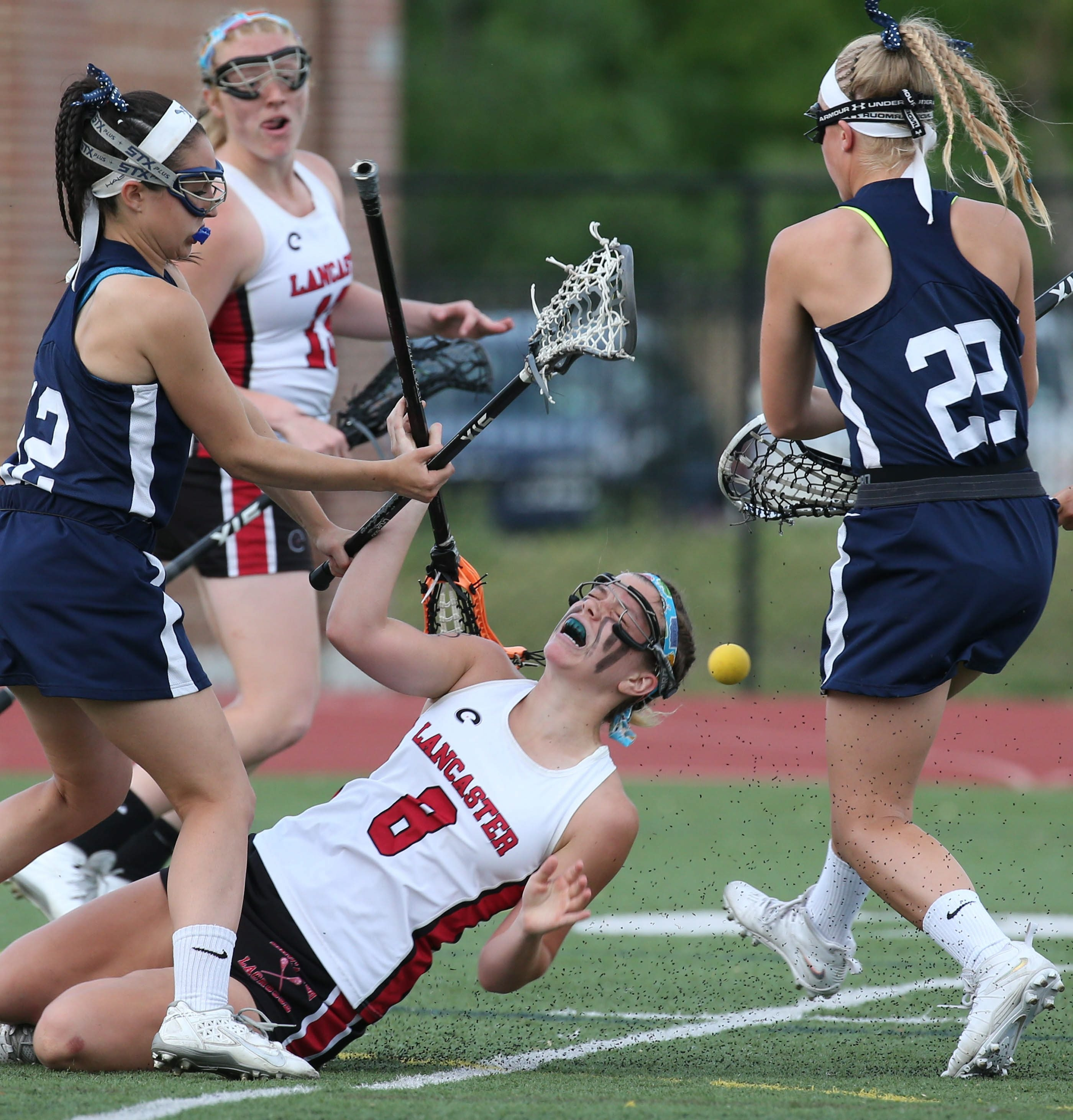 Lancaster's Grace Gabriel gets hit by Pittsford's Emily Wilson in the second half during the Class A Far West Regionals at All High Stadium.