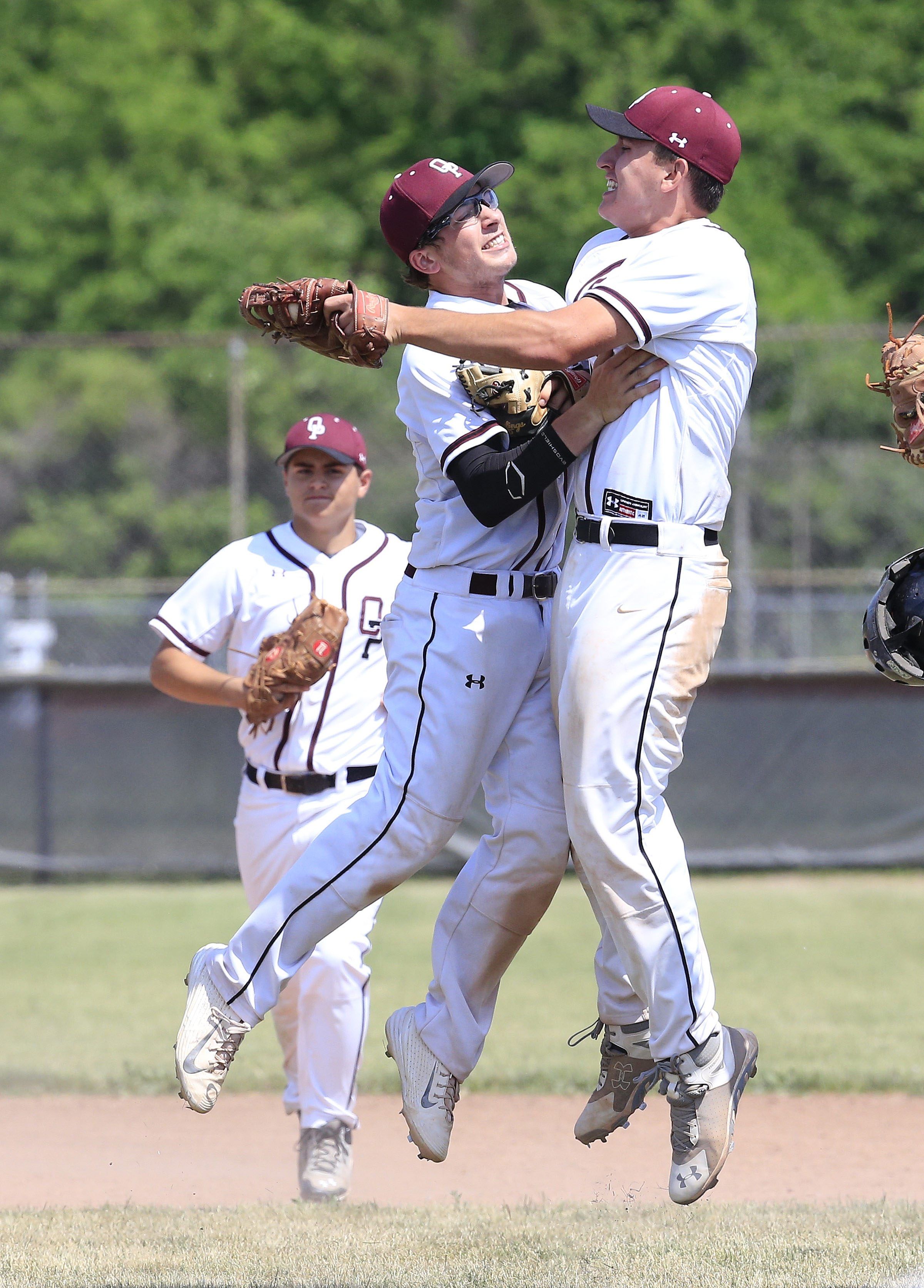 Orchard Park's Brandon Nicholson and Andrew Sipowicz celebrate winning the Section VI Class AA title against Niagara Falls.
