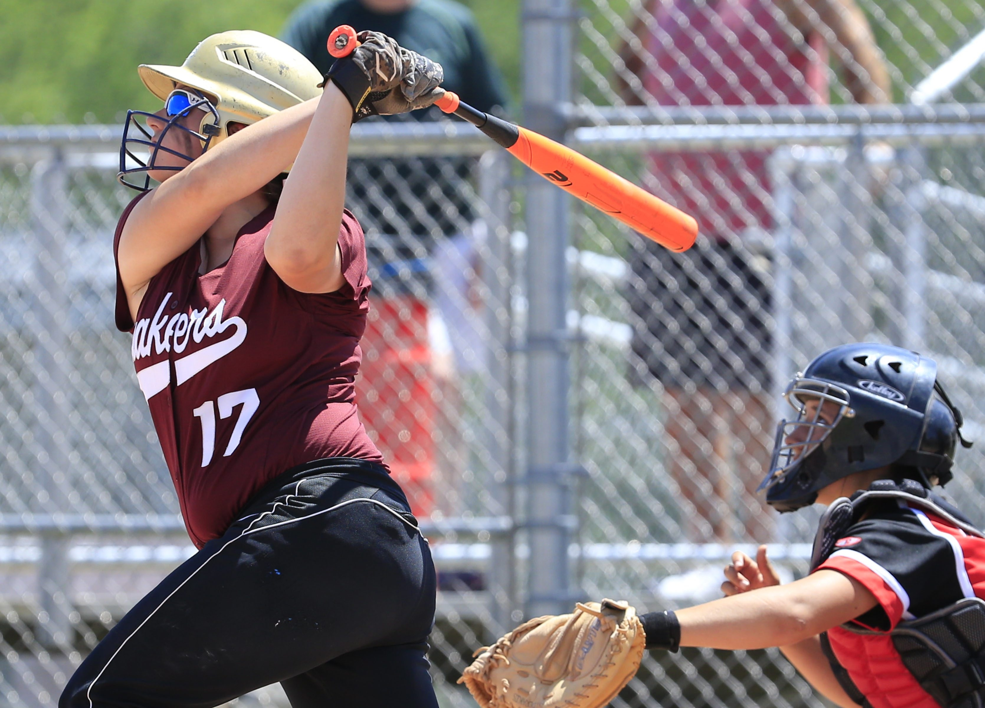 Orchard Park's Katie Weimer triples against Clarence to help the Quakers win the Class AA Section VI softball title on Saturday.