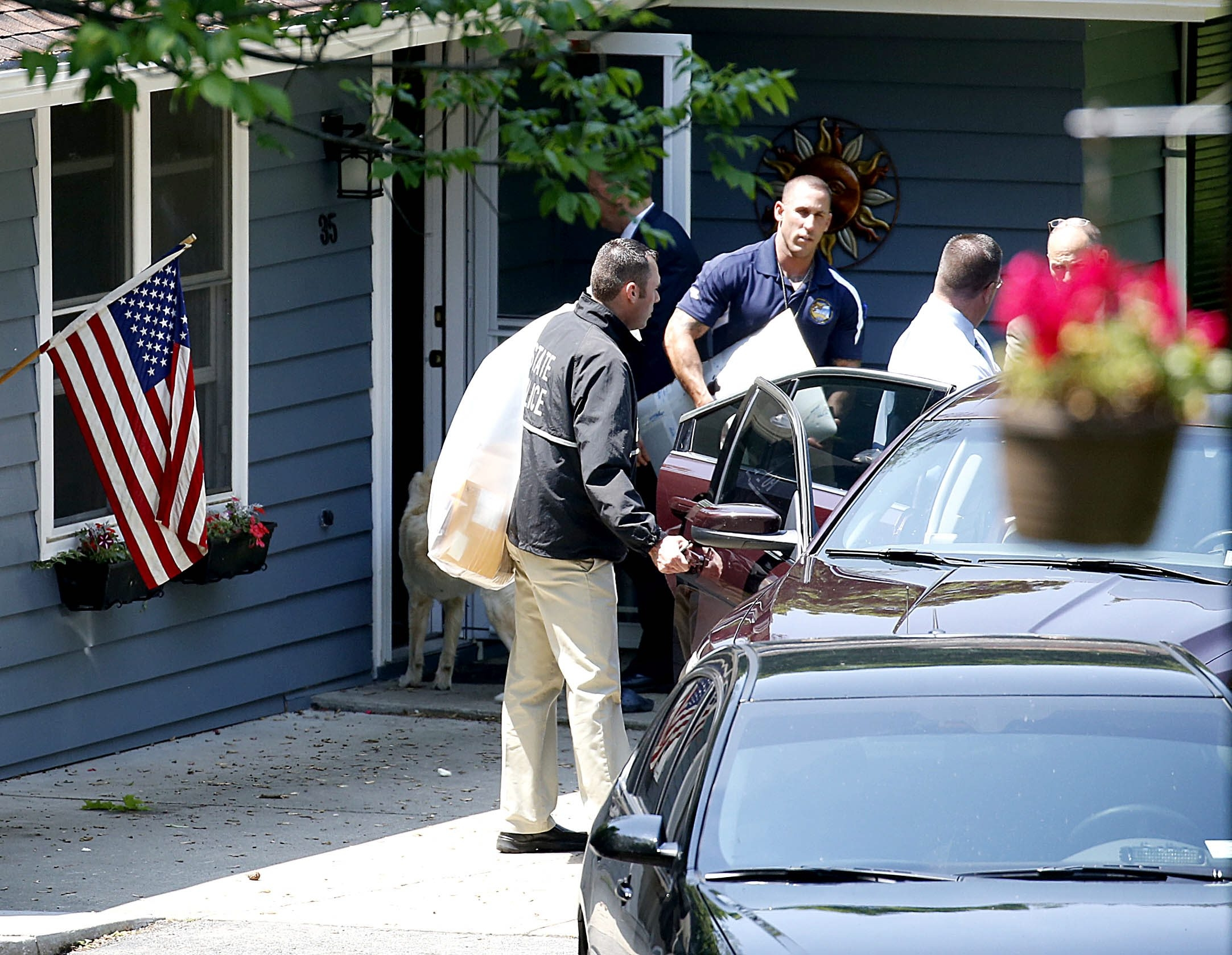 New York State investigators search the home of Steven Casey at 35 Park Lane South, East Aurora, on Thursday.
