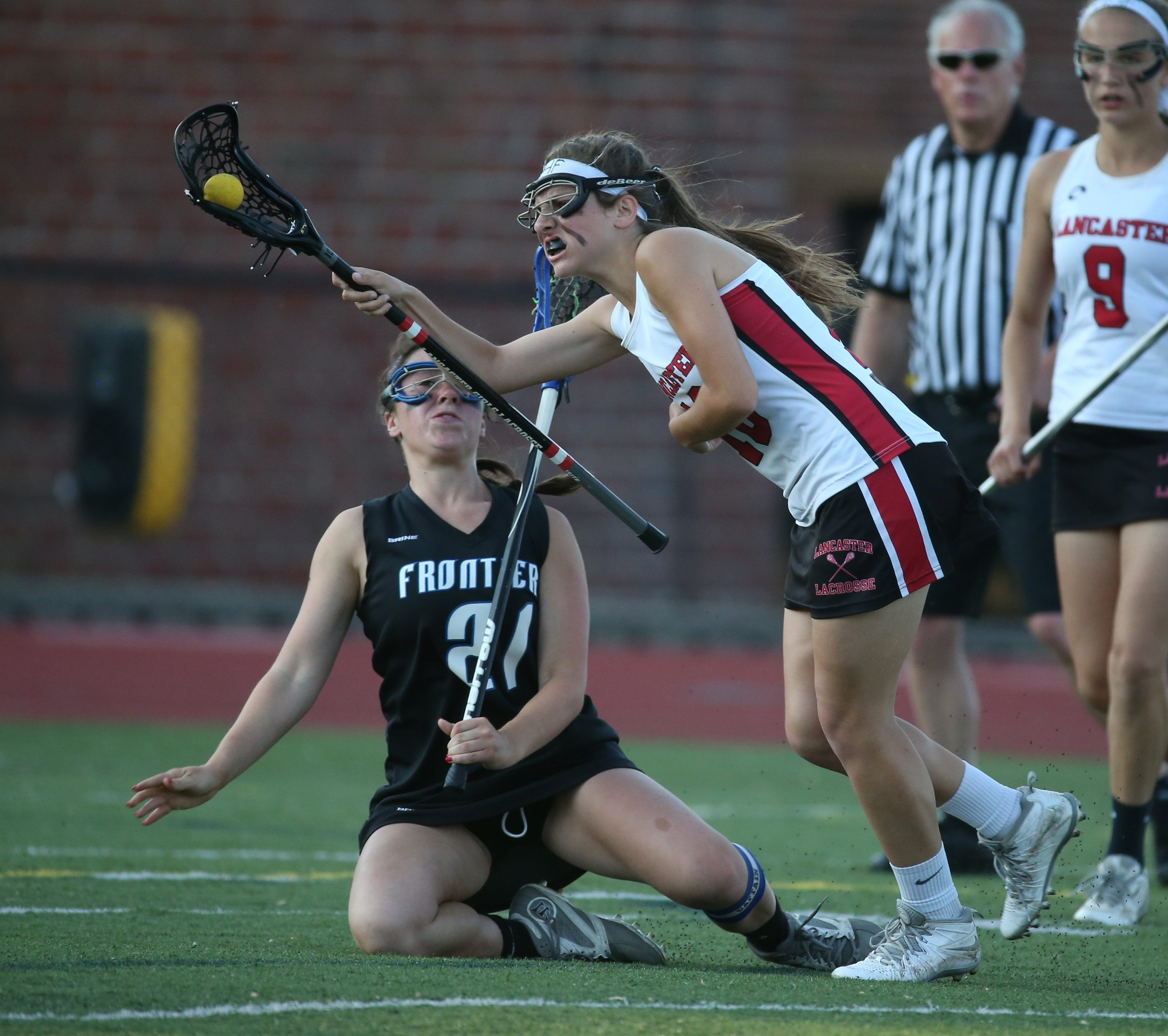 Lancaster's Riley Lucarelli battles Frontier's Michaela Kacmarski for the ball in the first half in the Class A section VI girls lacrosse finals at Robert E Rich All High Stadium in Buffalo,NY on Thursday, May 28, 2015.  (James P. McCoy/ Buffalo News)