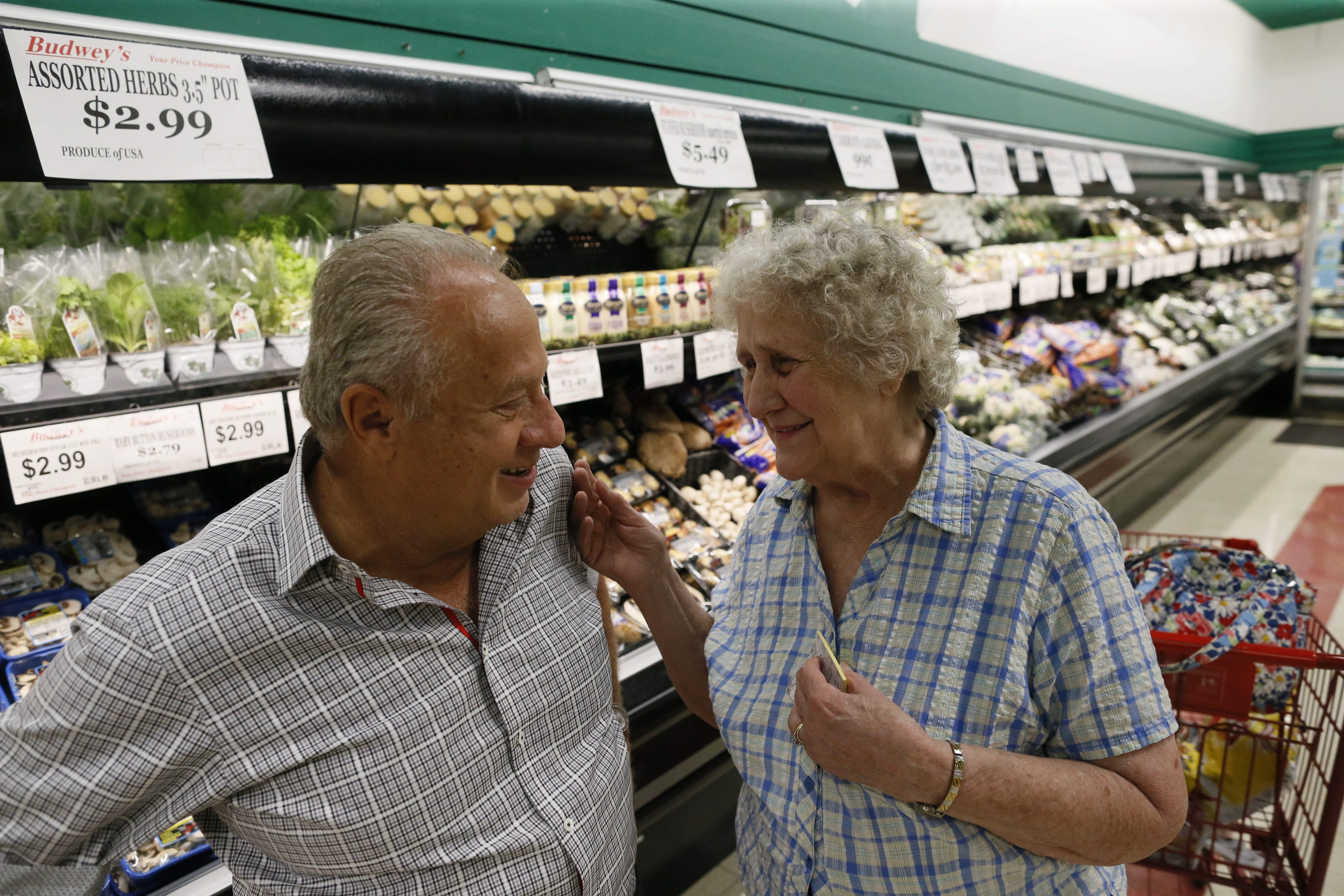 Frank Budwey, owner of Budwey's Supermarket since 1974, stops for a chat with long-time customer Marge Holesko of North Tonawanda, who has been shopping at the store for more than 54 years (when Budwey's parents ran it at another location down the road,) Tuesday, May 26, 2015.  (Derek Gee/Buffalo News)