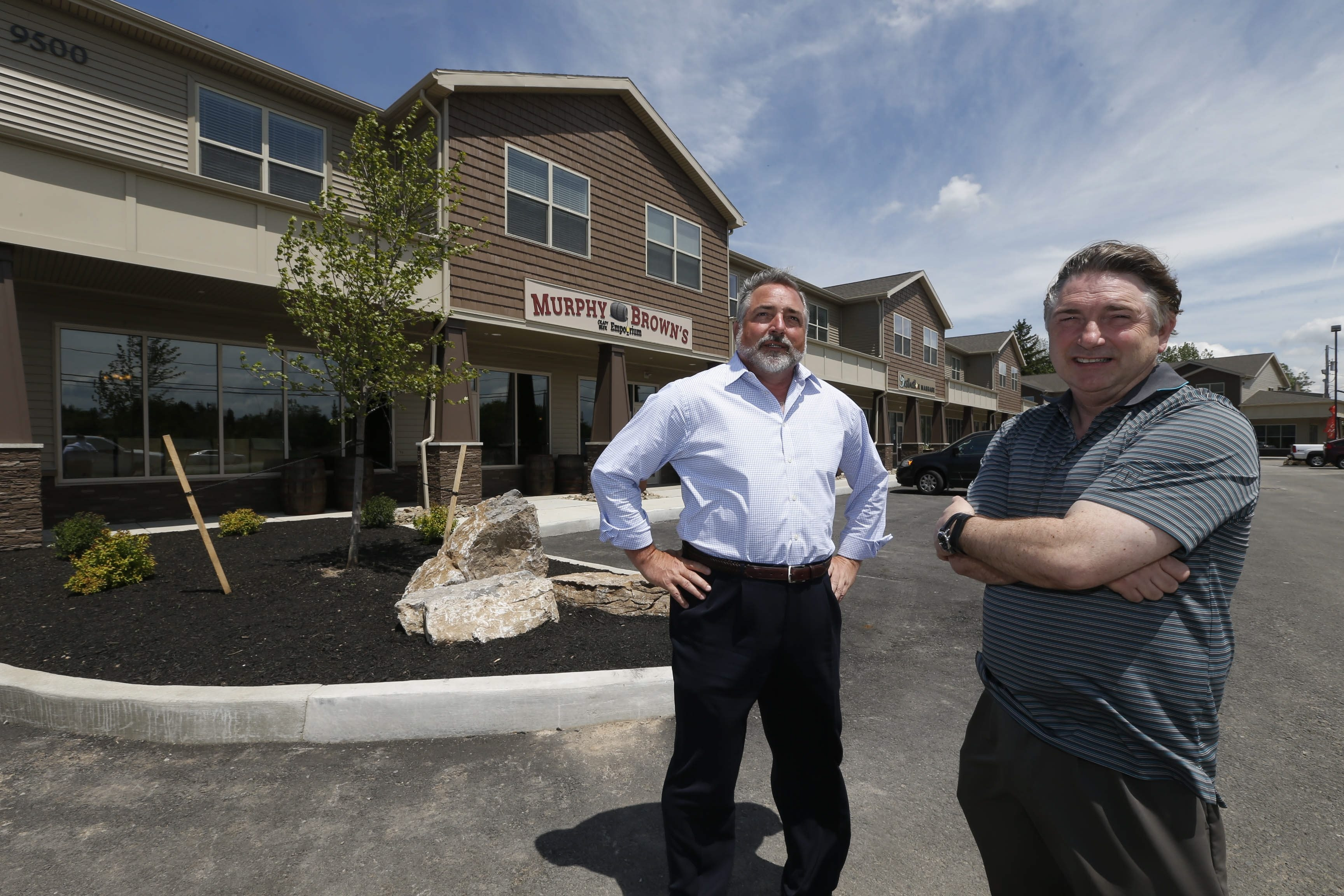 Jim, left, and Paul Stephen, development partners, outside their latest project at Main and Goodrich in Clarence.