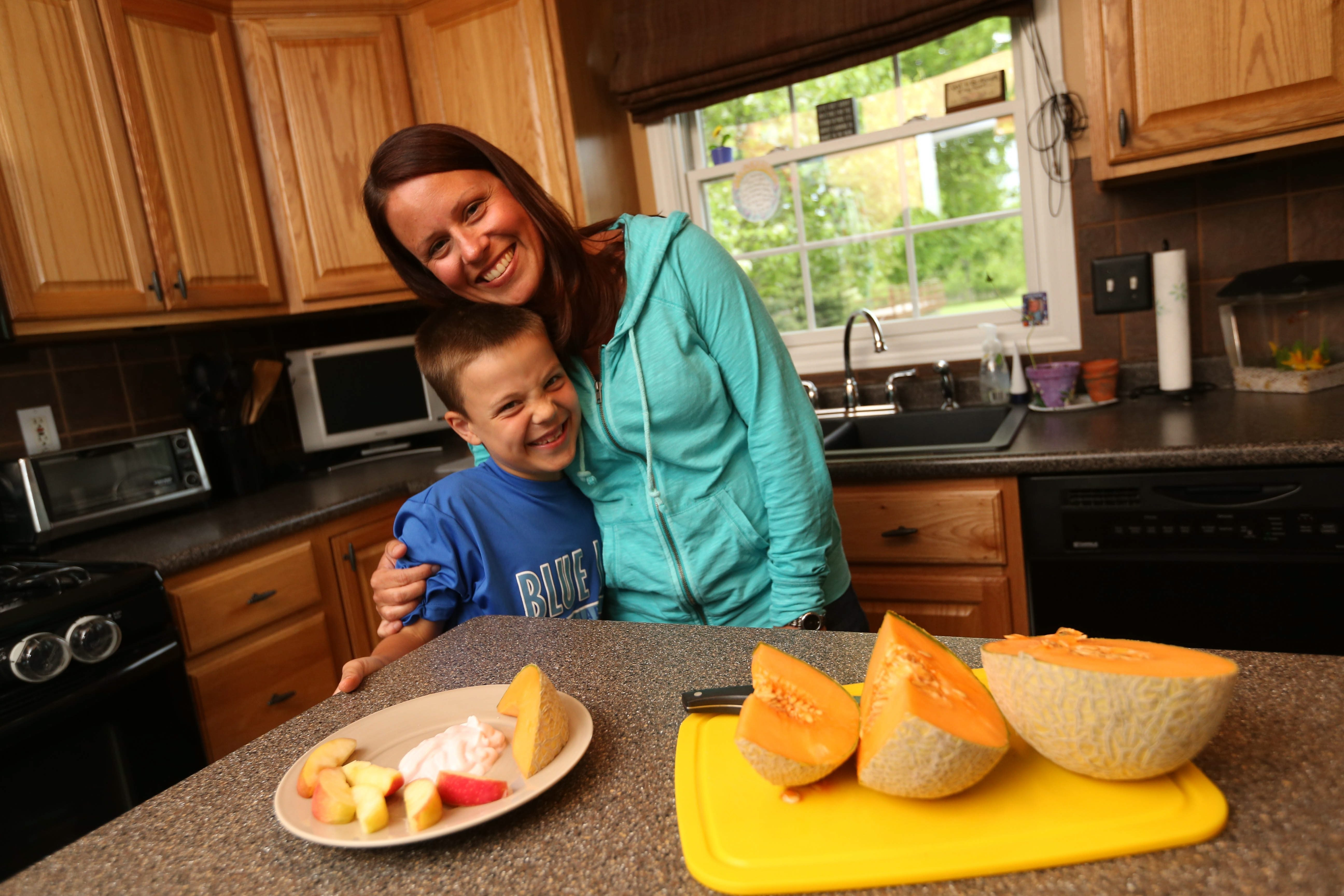 """""""Until a serious food allergy hits your family and you have to live with it every day – until you have to reconstruct your life – you don't know the impact it can have."""" – Nurse practitioner Kelly Naab of Clarence, with her son Cooper, 7, who has a life-threatening peanut allergy"""