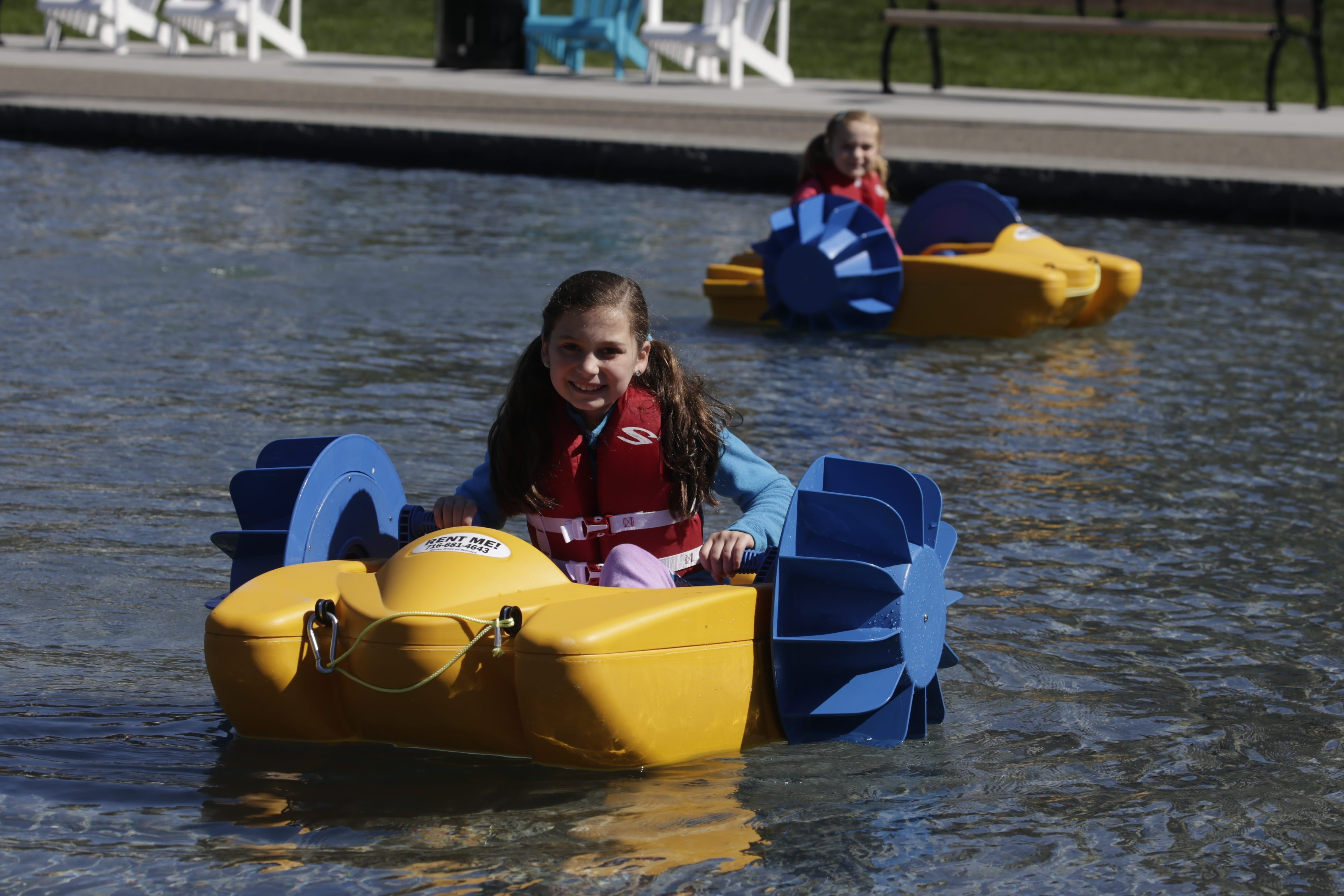 Amherst sisters Annabel Martin, 8, bottom, and Natalie, 6, try out the paddle boats.