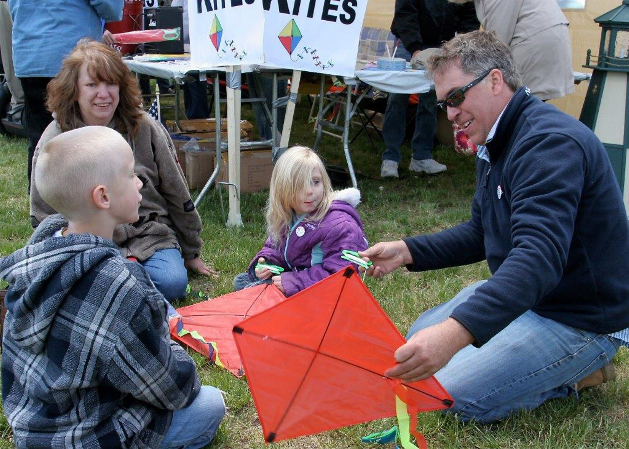 """Phil Arnold, at a previous """"Come Fly a Kite to Help a Homeless Veteran"""" with a mother and her children, is president/founder of Vets HERD (Help Empower Returning and Disabled)."""