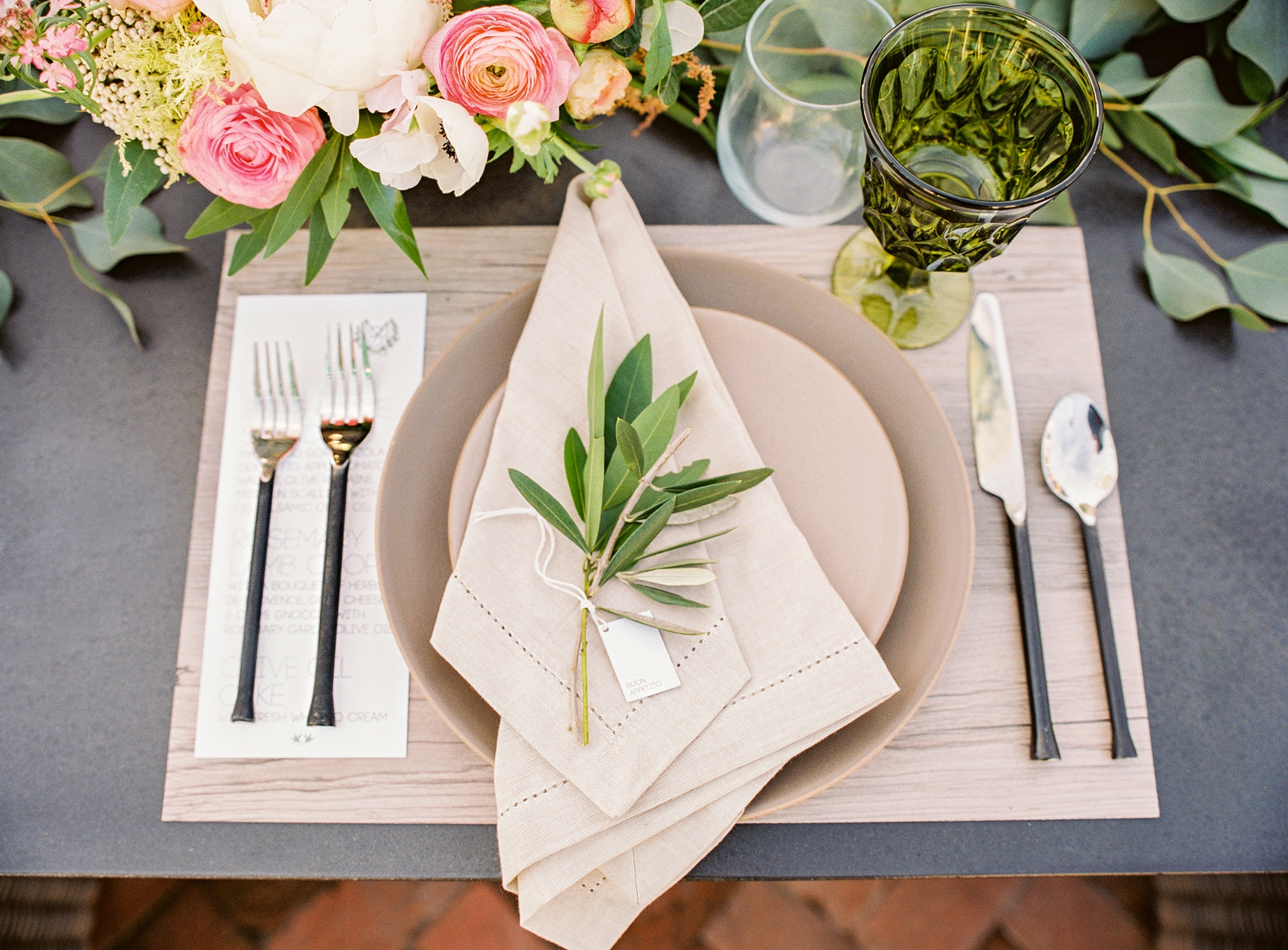 Karson and Butler like to use natural touches such as olive sprigs in their outdoor place settings. Illustrates DESIGN-OUTDOOR (category l), by Jura Koncius, (c) 2015, The Washington Post. Moved Thursday, May 14, 2015. (MUST CREDIT: Abby Jiu.)