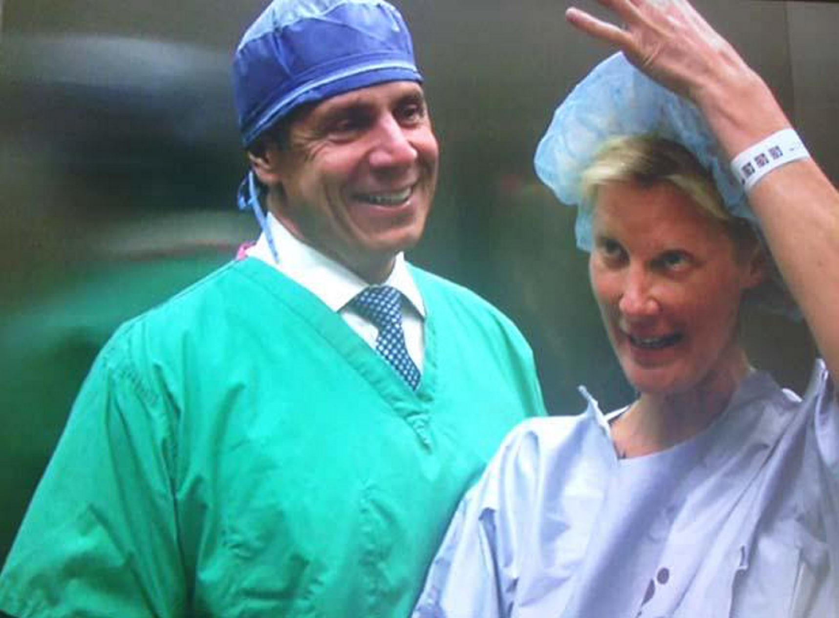 "Gov. Andrew M. Cuomo, shown here in hospital garb, says his girlfriend, Sandra Lee, ""is doing as well as can be expected"" after a double mastectomy."