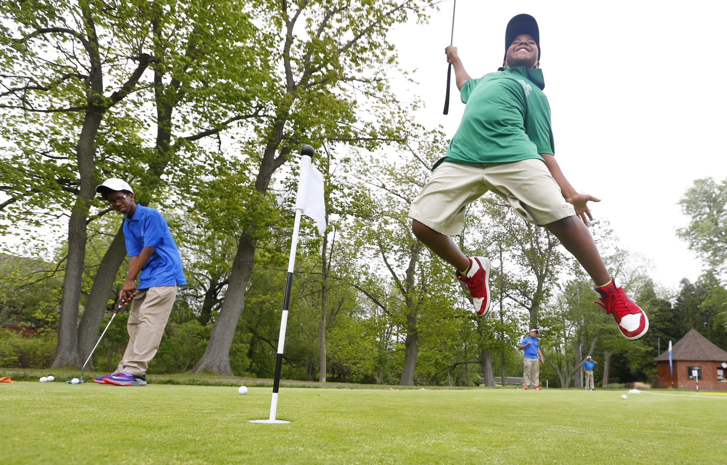 Photos by Harry Scull Jr./Buffalo News Kalen Baaith, a student in First Tee of Western New York, jumps for joy after making a putt during the Kids First Golf Classic at the Park Country Club  Monday.