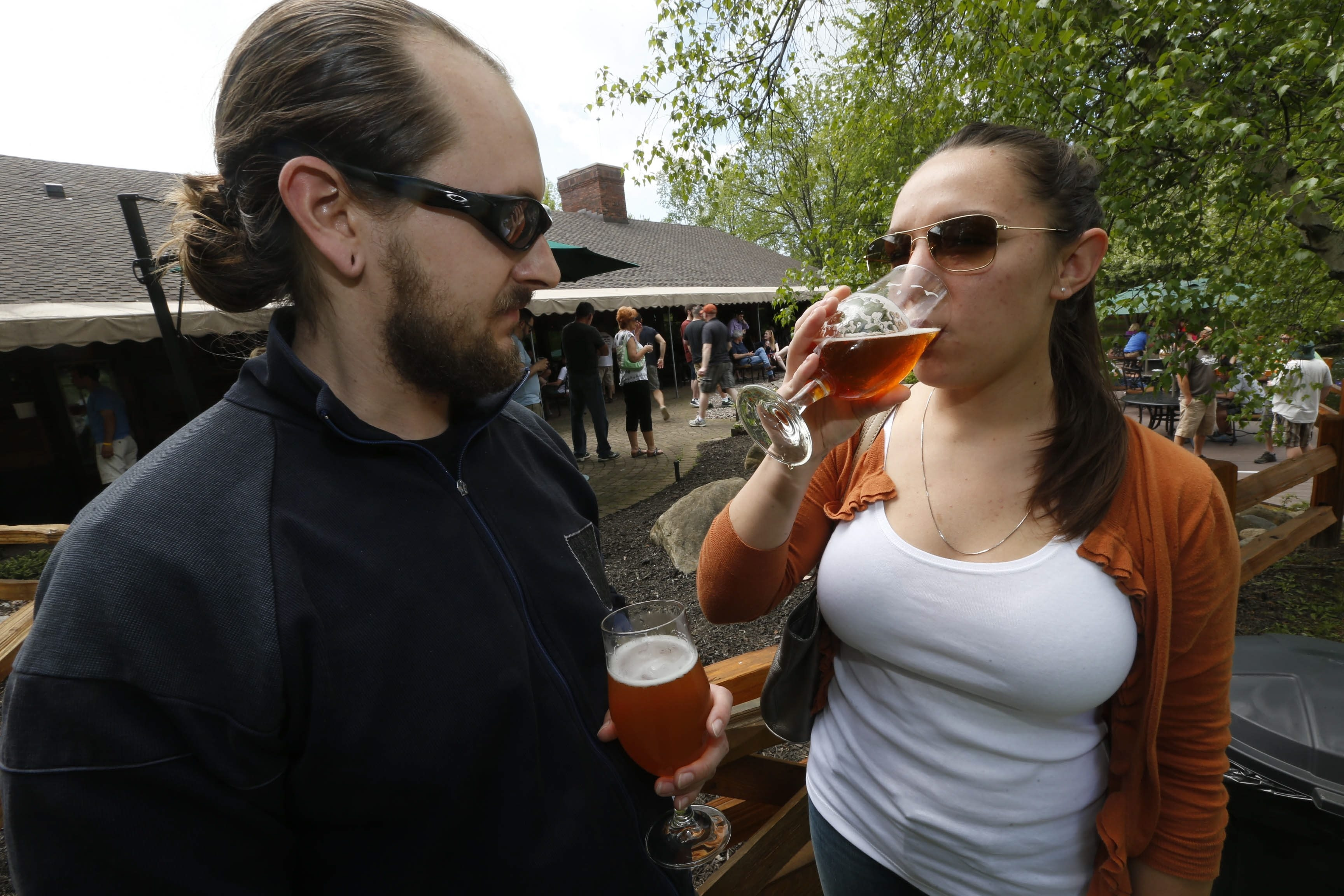 """Scott Dadille and his guest Maureen Kubiske sample the Hamburg Smoked Maple Ale at the """"farm to pint"""" happening at Hamburg Brewery in Hamburg on Sunday."""
