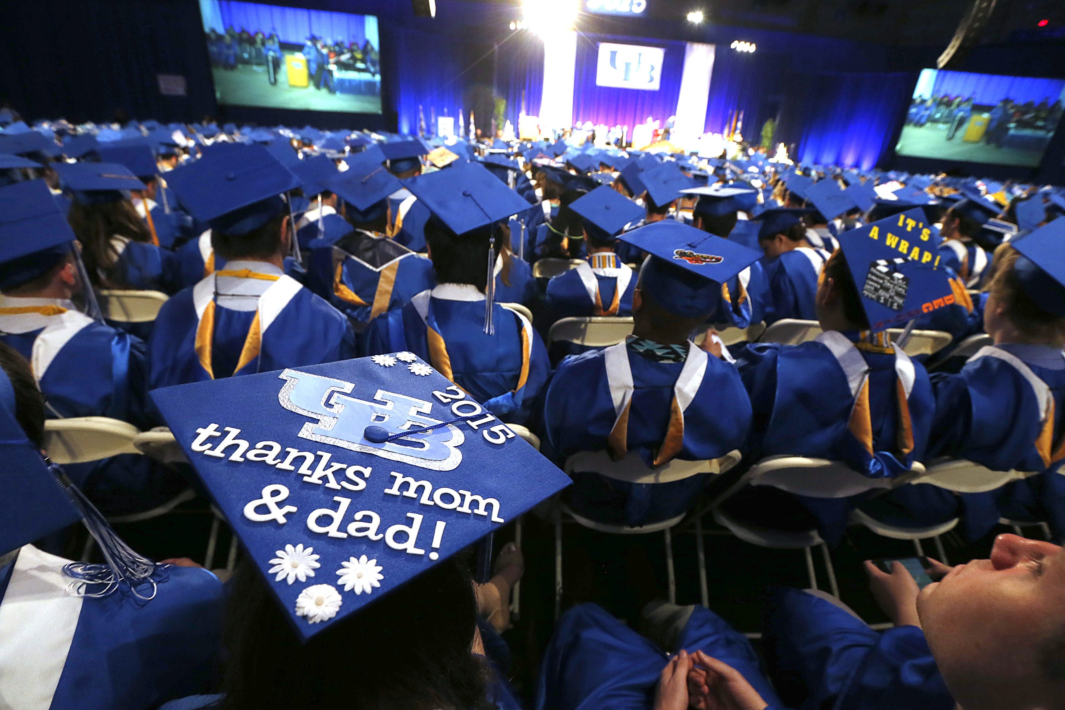 "One mortarboard sends a ""thanks mom & dad!"" message as 1,300 UB graduates receive degrees in Alumni Arena on North Campus."
