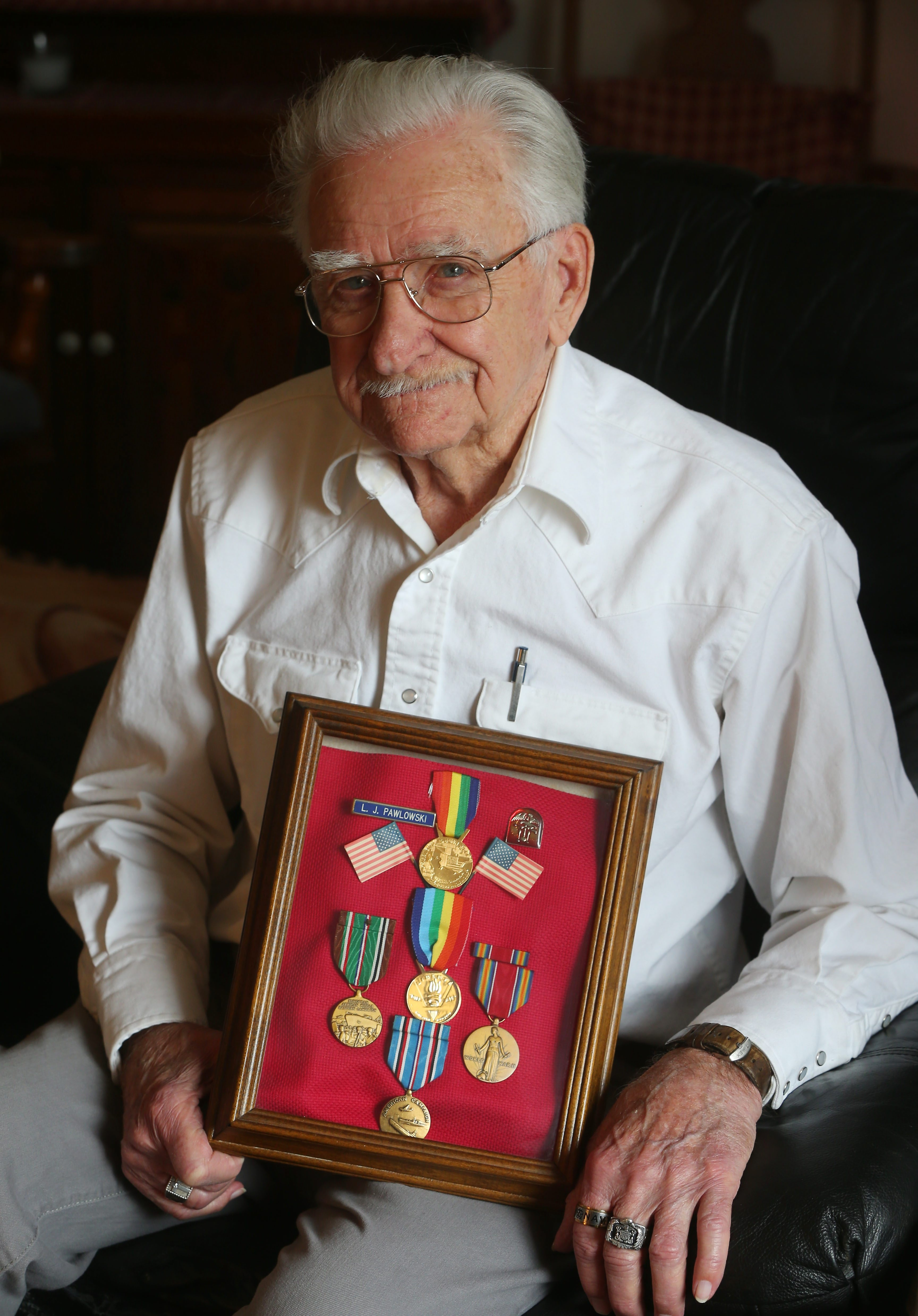 Leonard Pawlowski, with his medals, recalls buddy Chester Budziszewski.