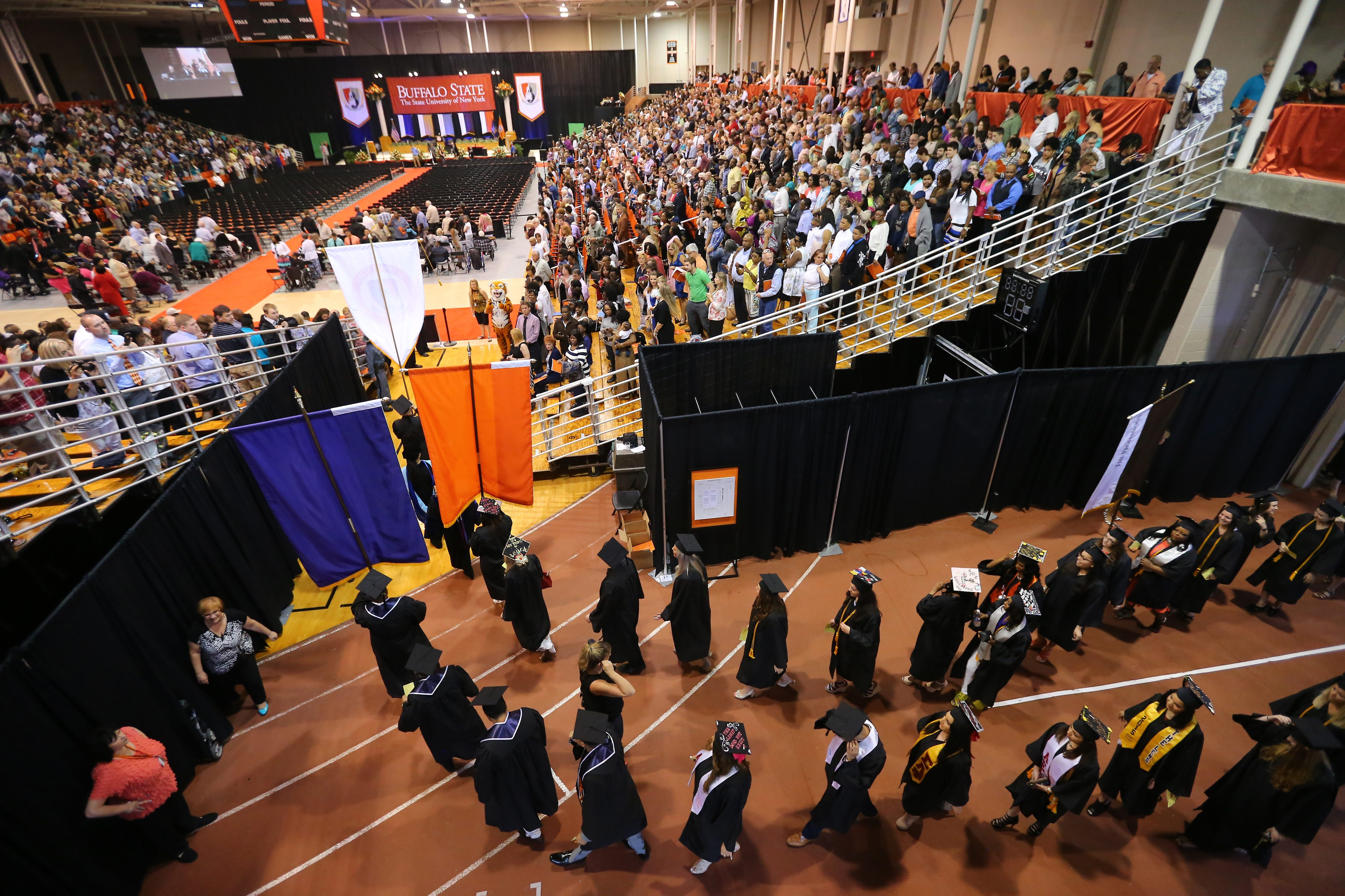 SUNY Buffalo State students march into the Sports Arena on the campus Saturday for their graduation ceremony. Nearly 2,000 undergraduate and more than 500 graduate students received their degrees.