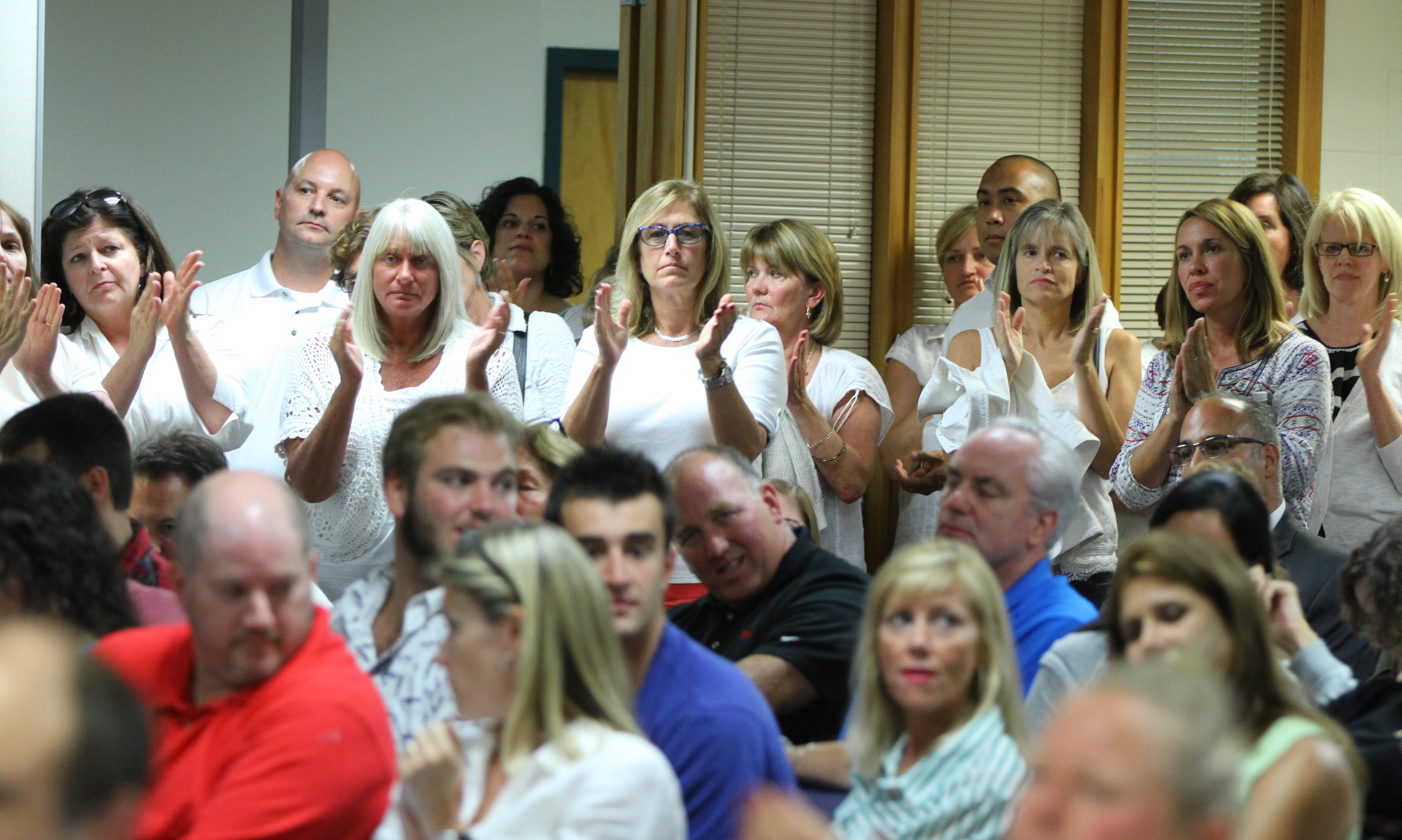 """Residents of Williamsville School District attending board meeting last September clap in support of the teachers union as continuing controversies have marked an end to the """"good times"""" and brought about a lively election with one-third of the board's seats at stake."""