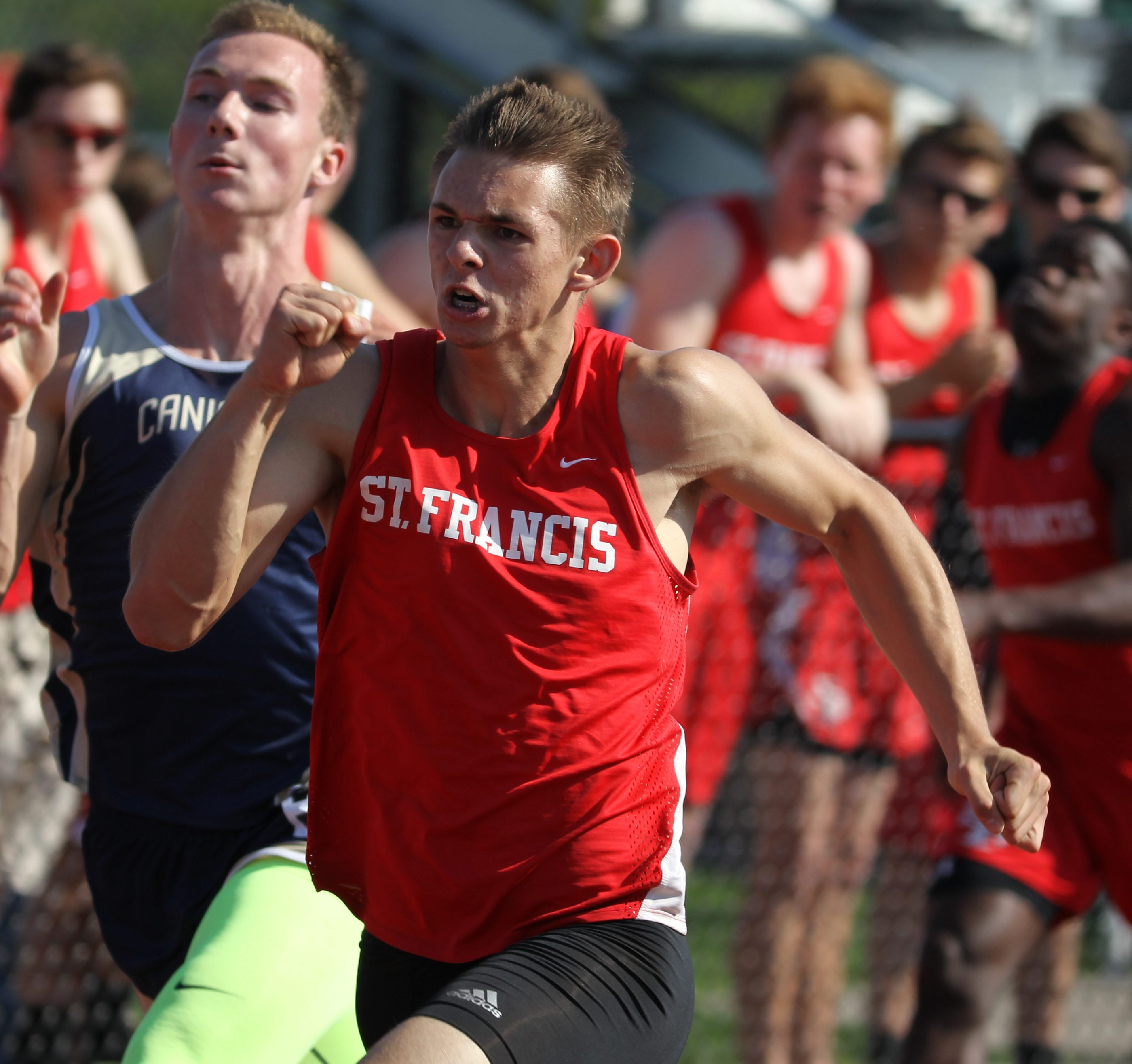 Nick Miller of St. Francis won his heat in the 100 meter dash during the All Catholic track and field championships in West Seneca on Monday.