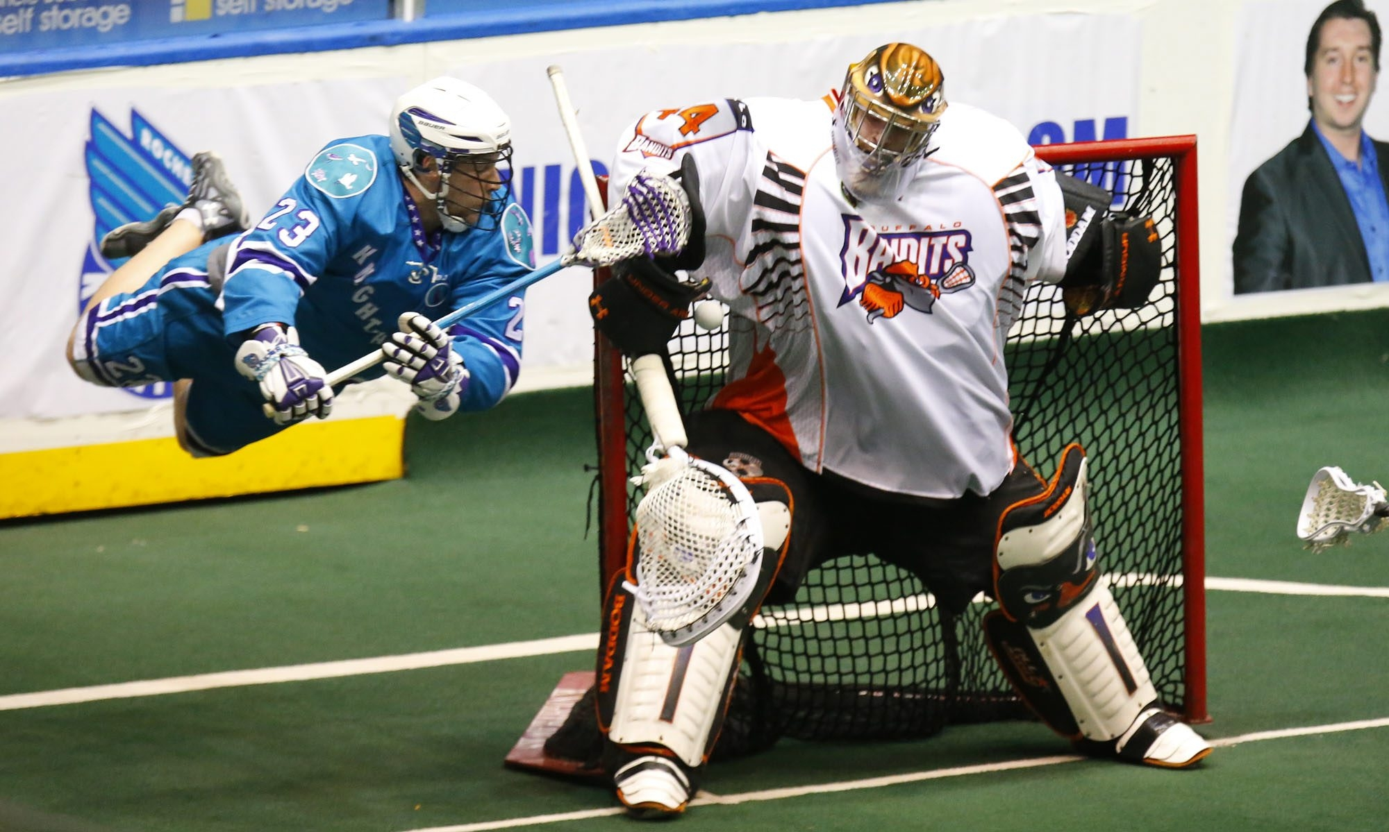Buffalo goaltender Anthony Cosmo cannot stop Rochester's Cory Vitarelli from scoring in the second half of their NLL playoff game.
