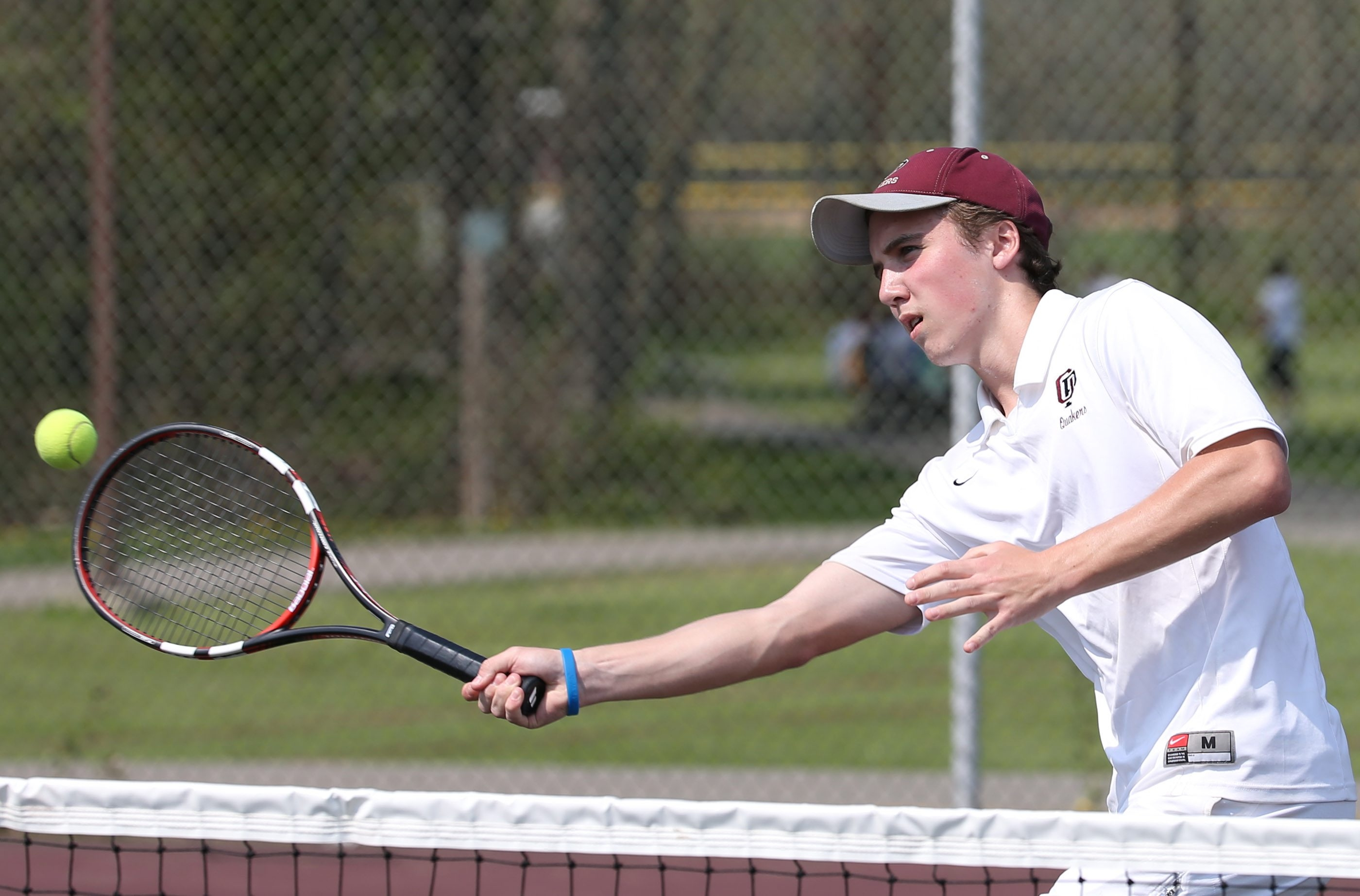 Jack Watson and his partner Noah Sayoc (not shown) won at second doubles, 6-4, 6-1, for Orchard Park during the Quakers' 5-0 triunph over Frontier on Friday.