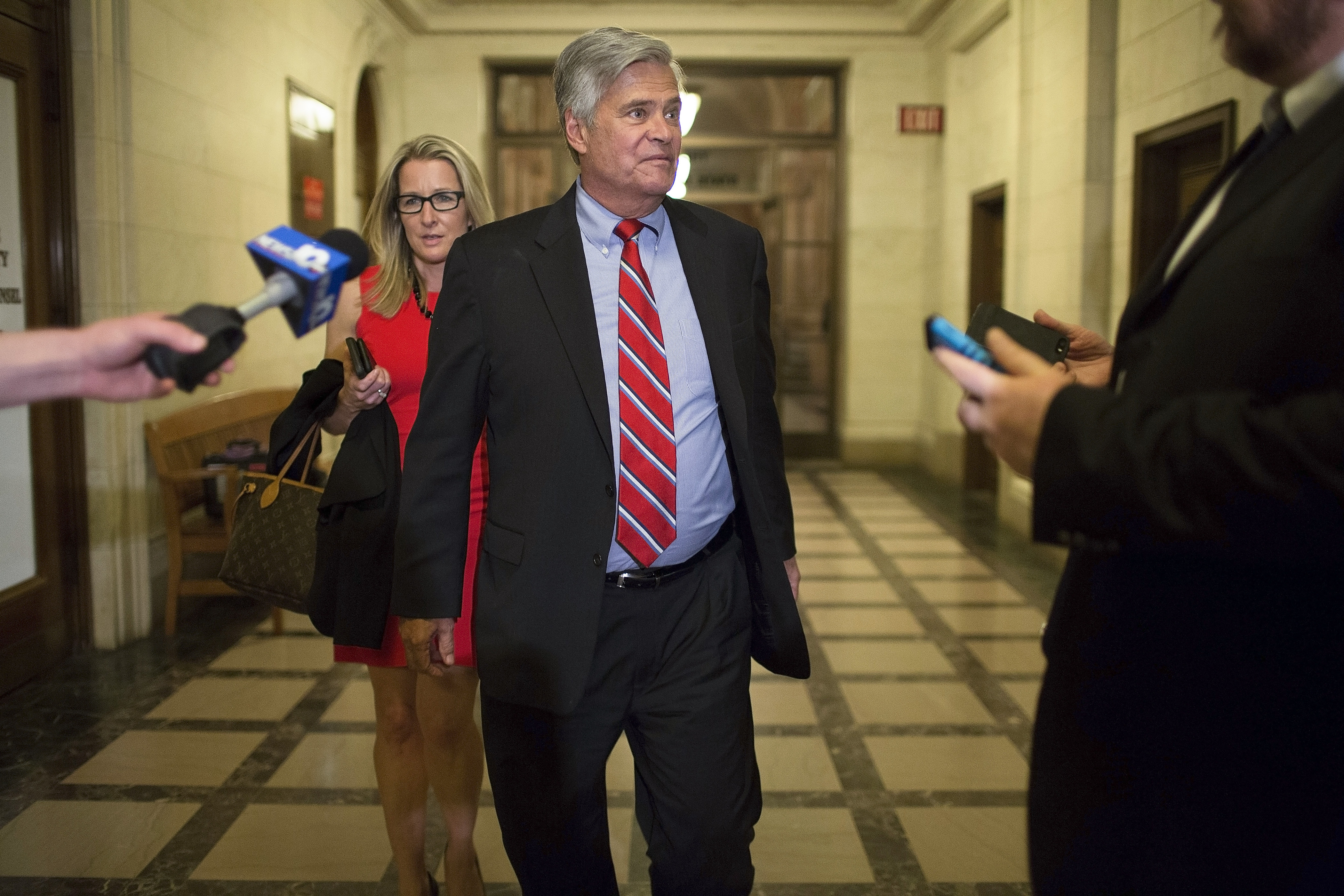 New York State Sen. Majority Leader Dean Skelos returns to the State Capitol Monday evening to meet with his Senate Republican colleagues after being arrested in Manhattan that morning. (The New York Times)