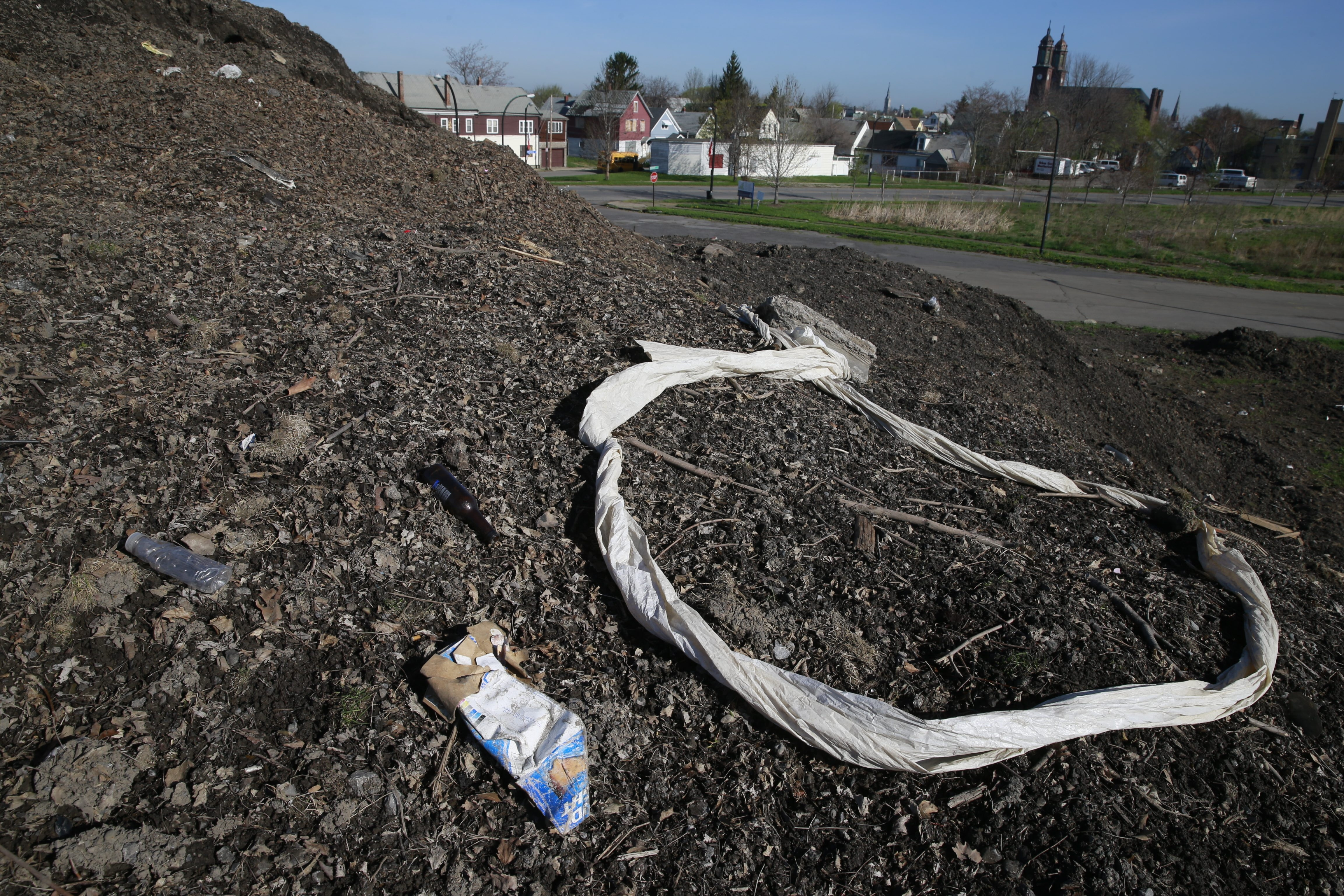 """After 11,000 truckloads of snow were dumped on five acres near the Central Terminal from last winter's megastorm, what's left are dirty mounds. Public works chief Steven J. Stepniak expects them to """"melt off when we get a couple of good rains and the temperature rises."""""""