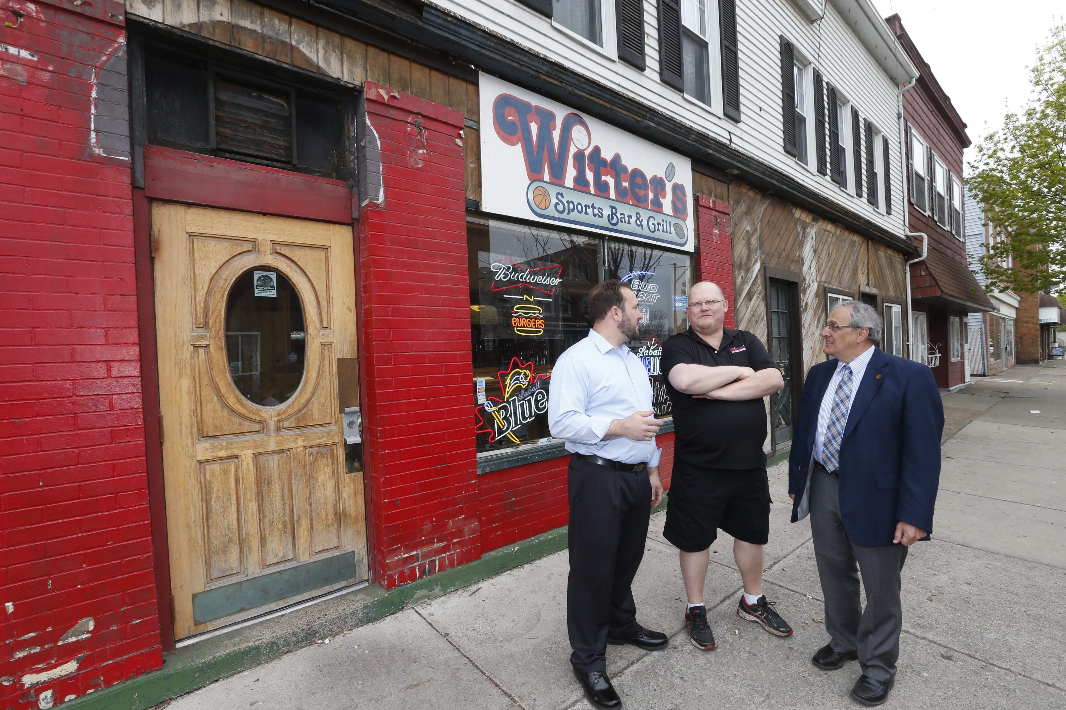 Discussing an Oliver Street comeback are, from left, Niagara County Legislator Richard Andres, Witter's Sports Bar & Grill owner Peter Witt and Mayor Arthur Pappas. State grant money is helping Witt and his wife, Shelley, upgrade their business.