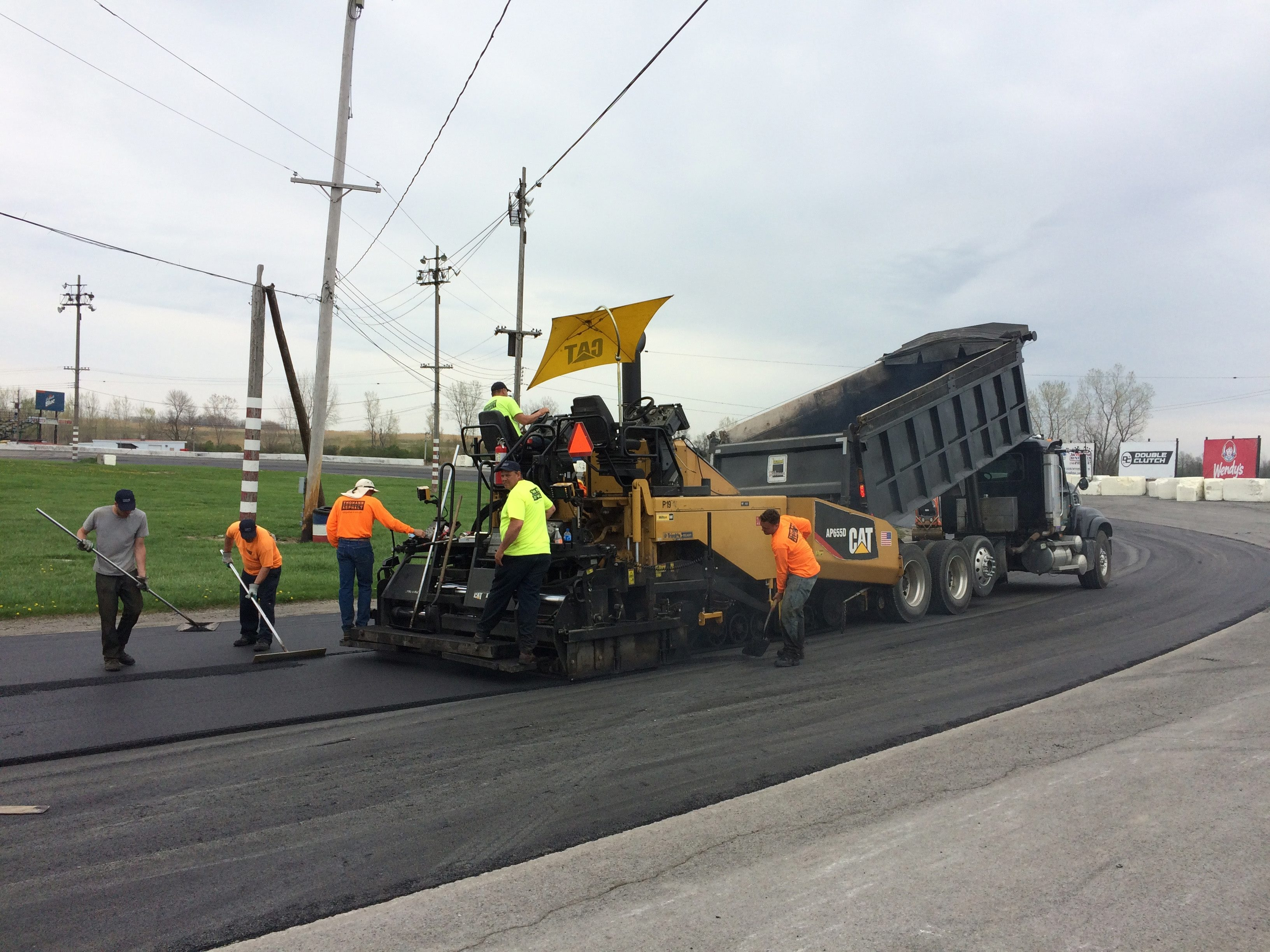 Crews lay down new asphalt on the track's oval at the Lancaster National Speedway – just one of the improvements underway at the racetrack, with more planned as finances permit.