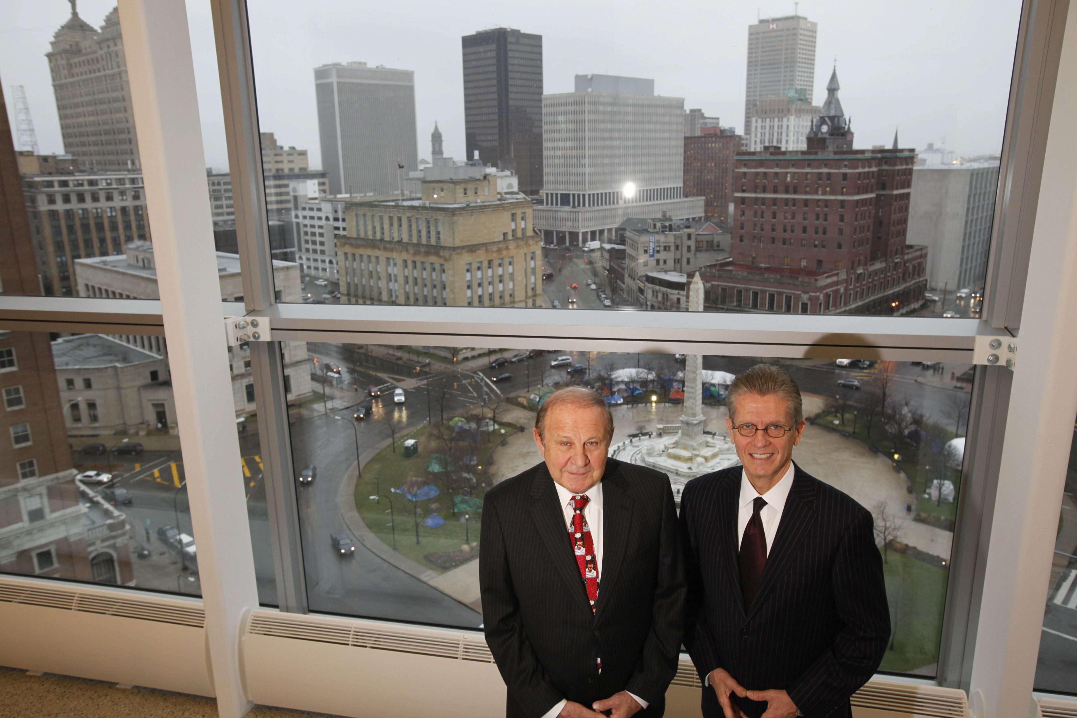 Retired U.S. District Court Judges Richard J. Arcara, left, and William M. Skretny continue to carry heavy caseloads while their two posts sit vacant.