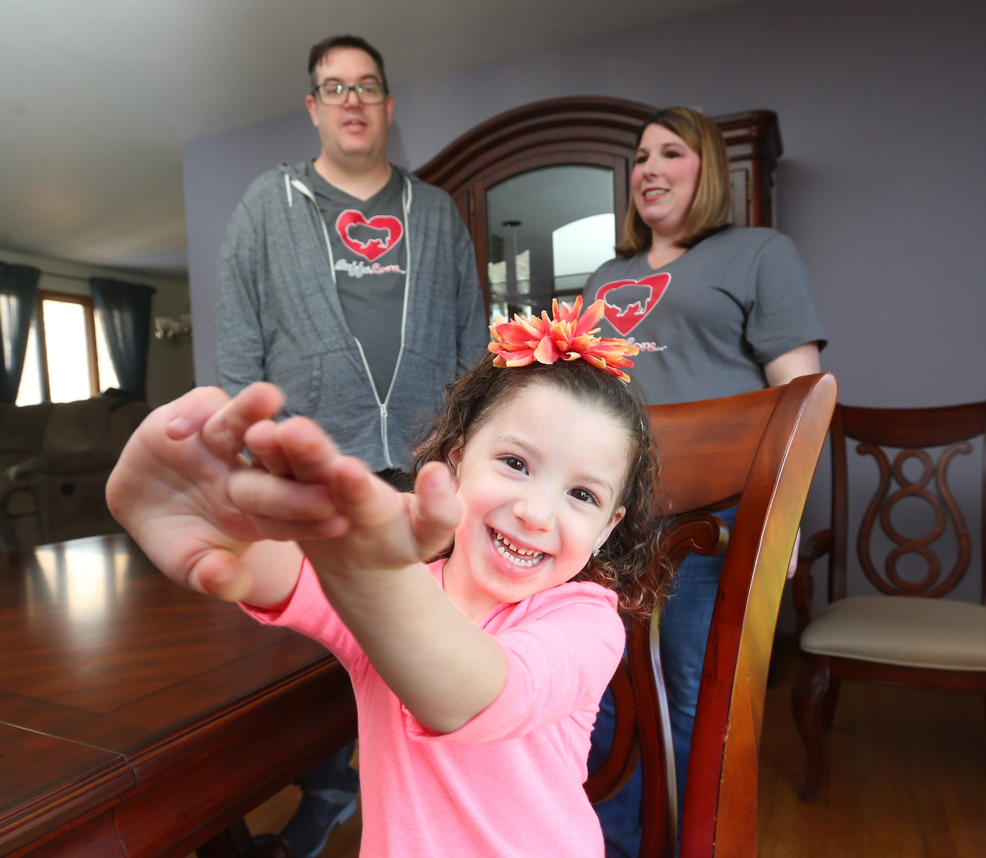 A symbol of hope for family, friends and community, cancer patient Maya Serra, who will turn 4 on May 24, enjoys time at her Lewiston home with mother Renee as they are visited by James Sheehan, who's reaching out to help through his new nonprofit.