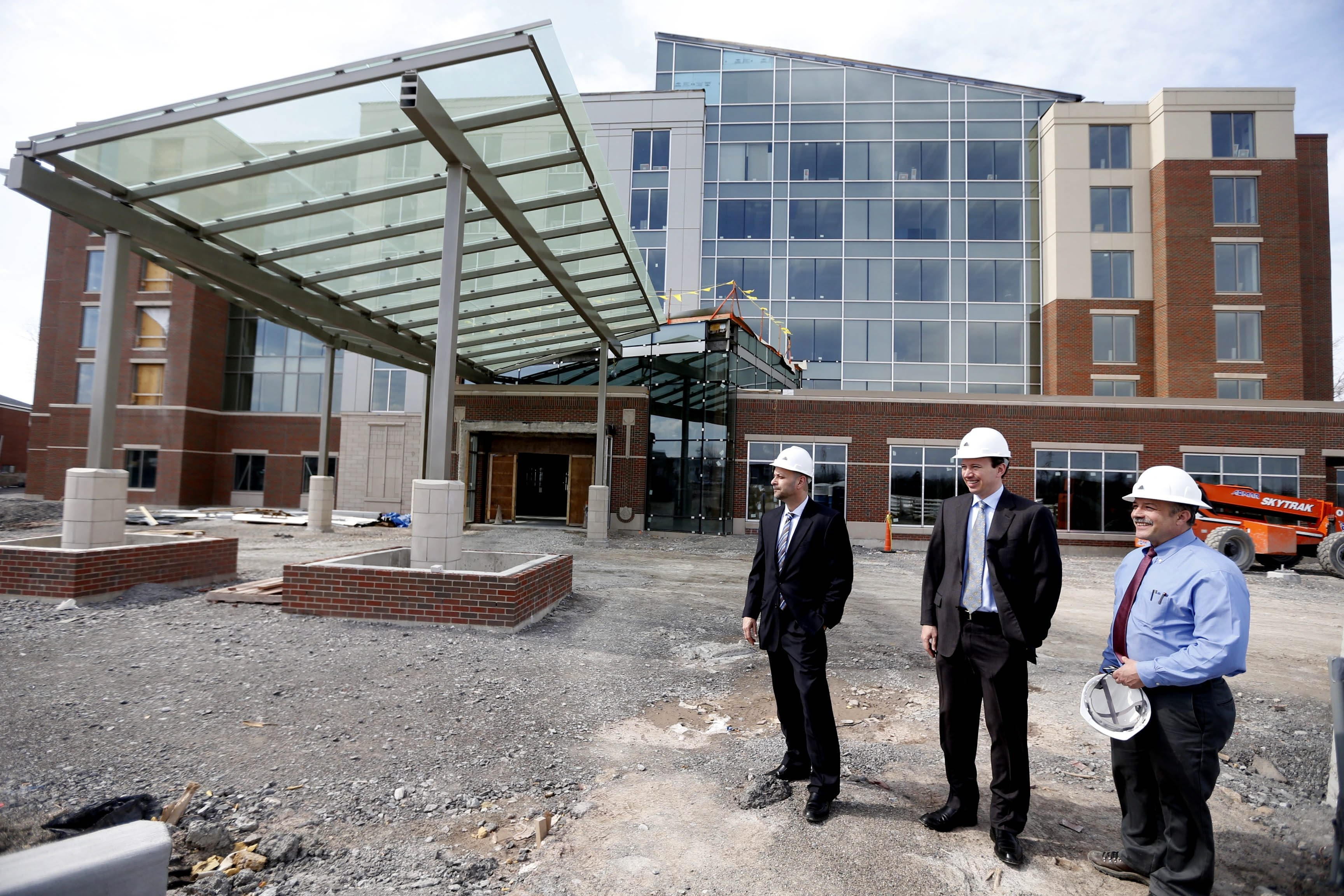 From left, David Chiazza, Executive VP with Iskalo, Paul B. Iskalo, president and CEO and William M. Clark, project manager, during a tour of the new Hyatt Place Amherst property near the the old Lord Amherst Hotel on Main St. in Amherst on Monday, April 13, 2015.  (Robert Kirkham/Buffalo News)