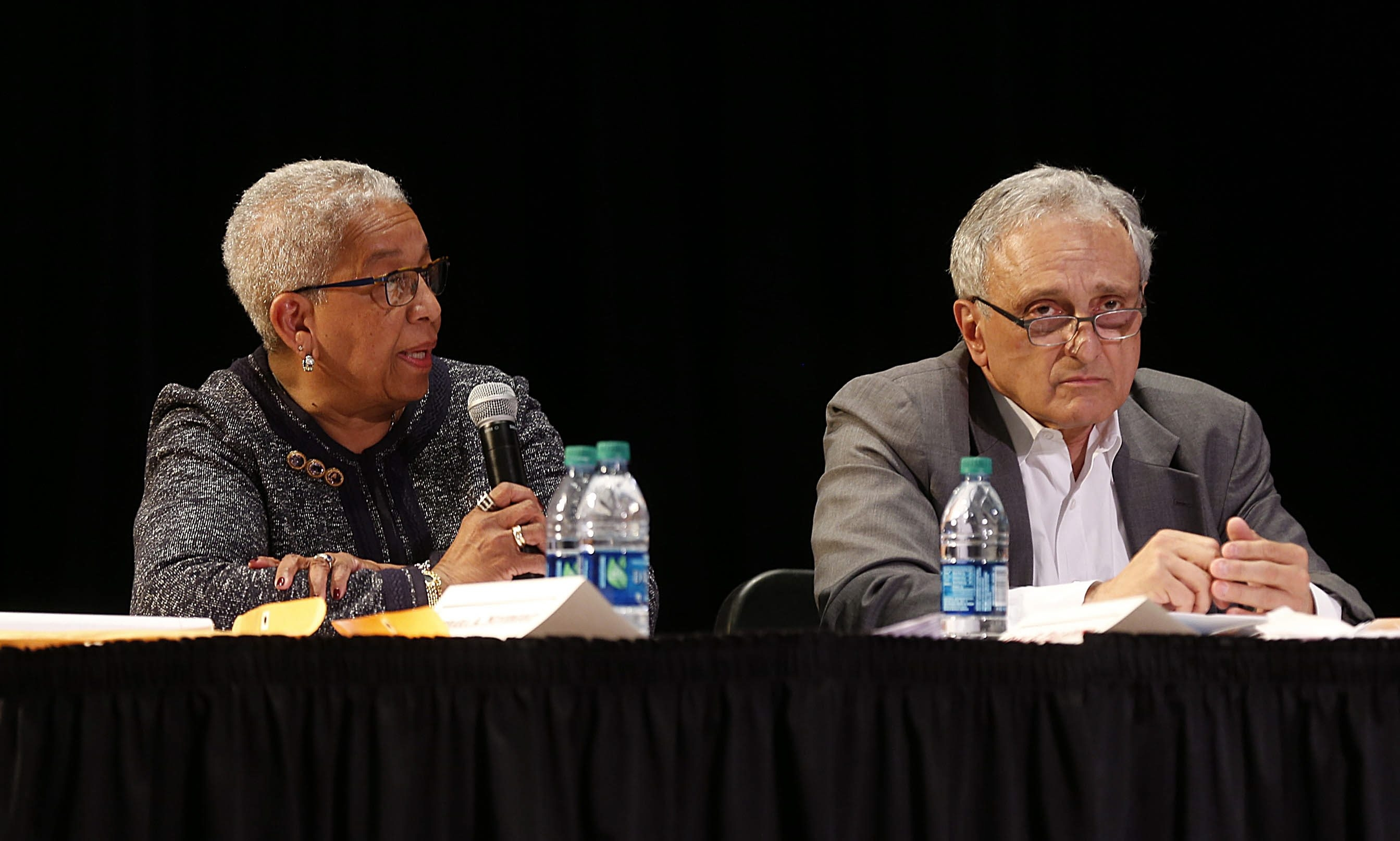Buffalo Board of Education members Barbara Seals Nevergold, left, expresses her dissatisfaction with the way the board's majority – which includes Carl Paladino, right – attempted to unilaterally select a school superintendent without consulting the board minority or the community. The meeting took place Wednesday at the Academy for Visual and Performing Arts on Masten Avenue.