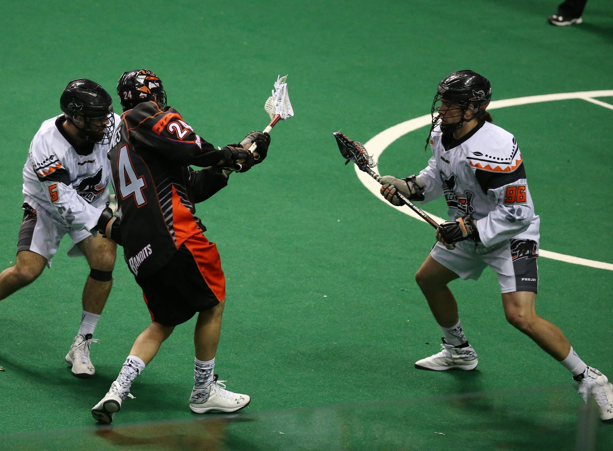The Bandits' Mitch Jones lets go a shot past New England's Mike Manley during the first quarter of action Saturday night at First Niagara Center.
