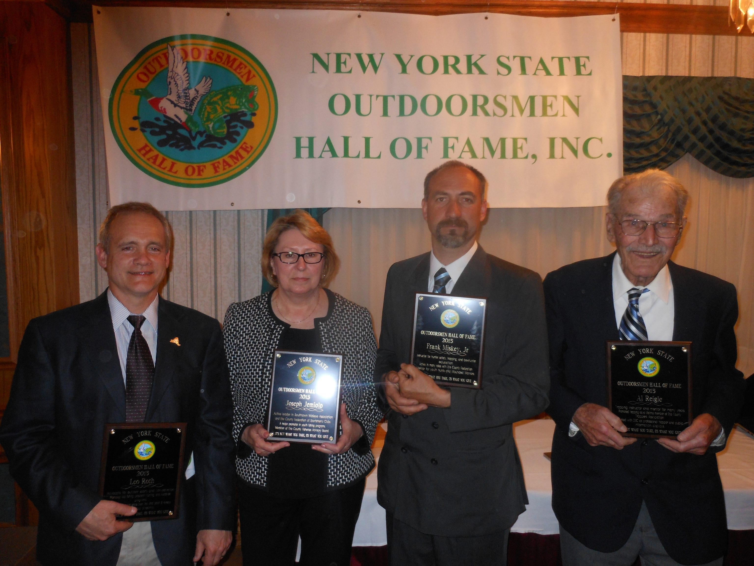 Leo Roth, Margaret Jemiolo, widow of Joseph Jemiolo Jr., Frank Miskey Jr. and Al Reigle accepted inductions into the New York State Outdoorsmen Hall of Fame on April 25.