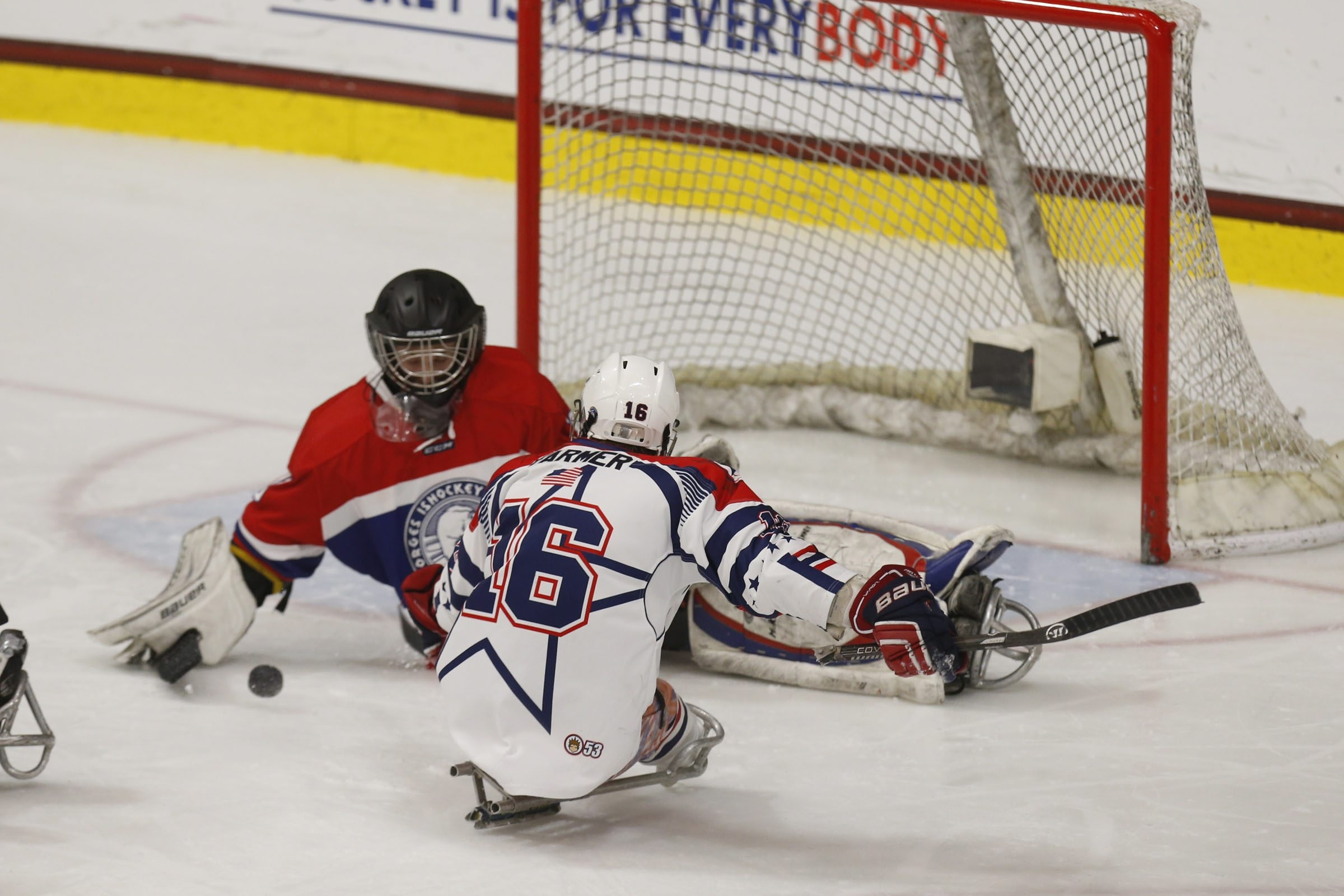 USA's Declan Farmer scores against Norway during the first period of their Sledge Hockey World Championships semifinal.