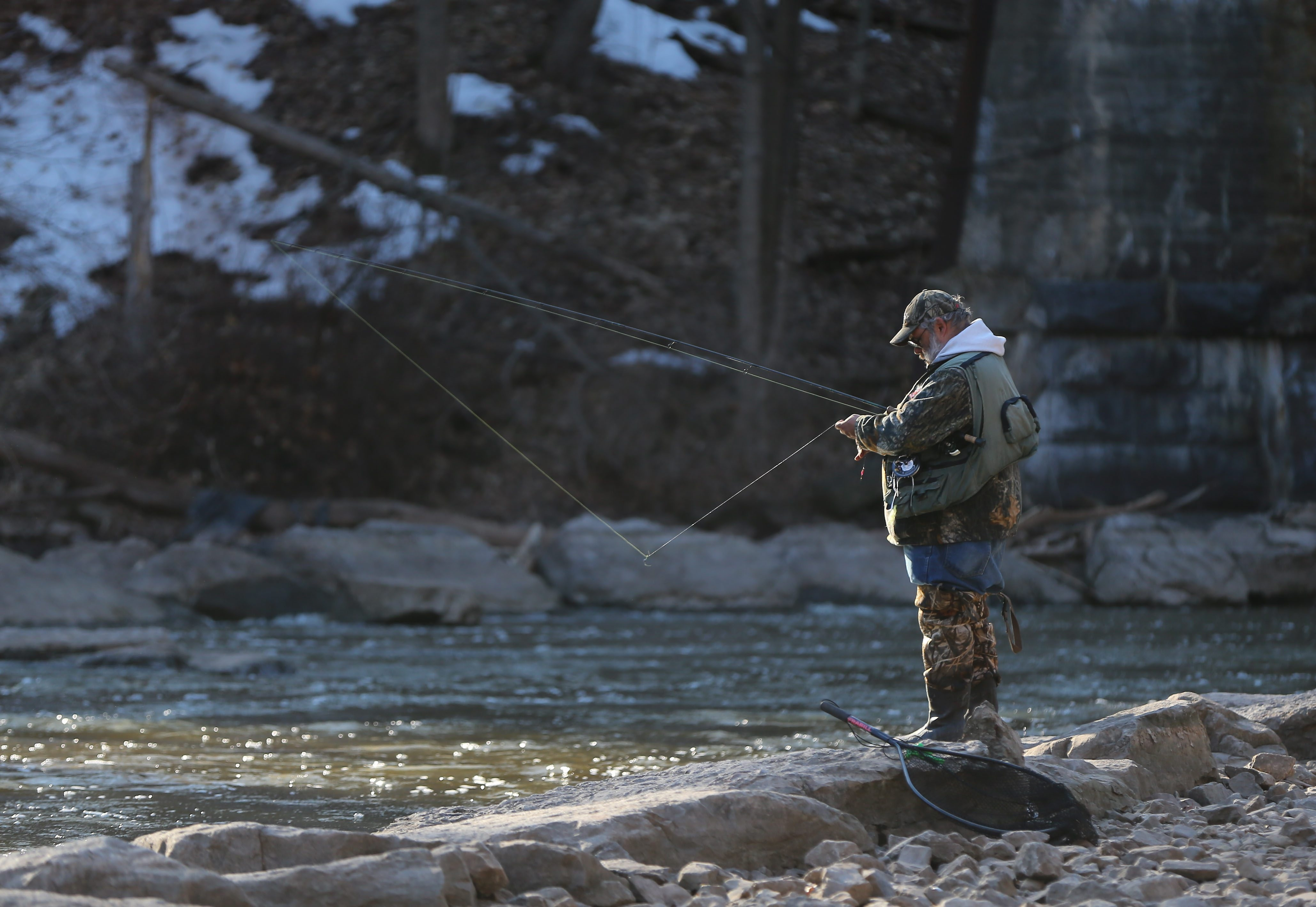 """Phil Brogan, of Ohio, casts his line at the Town of Newfane's Fisherman's Park. Officials say Olcott was named the """"Ultimate Fishing Town"""" in 2012 by the World Fishing Network."""