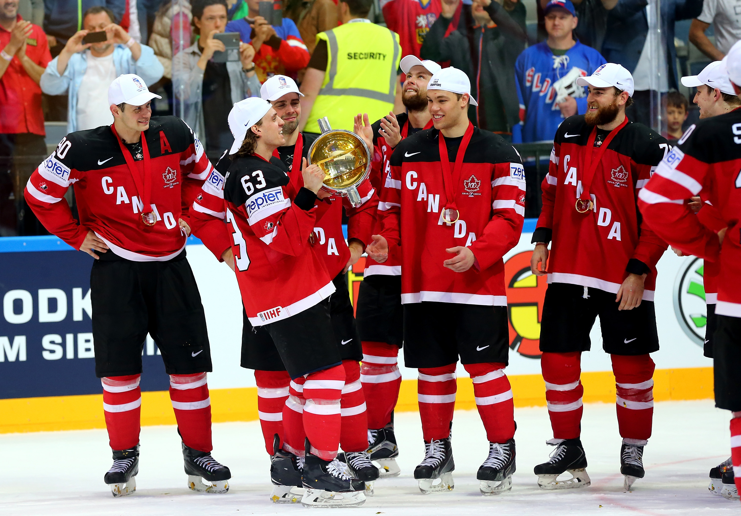 Tyler Ennis of the Sabres takes his turn with the World Championship trophy. Ennis had a goal and assist in Canada's 6-1 win over Russia.