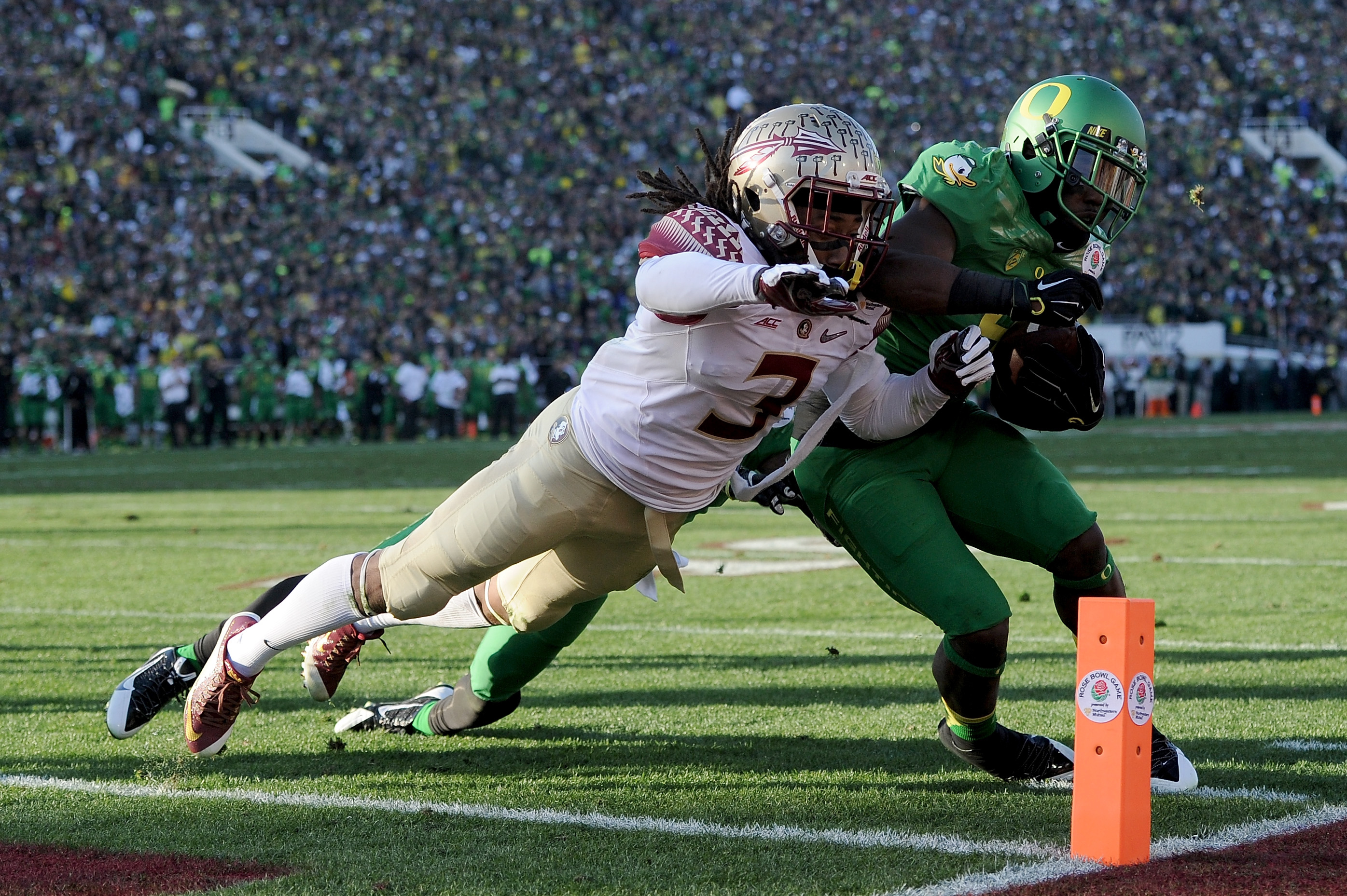 Running back Byron Marshall of the Oregon Ducks is hit out of bounds at the one-yard line by cornerback Ronald Darby of the Florida State Seminoles during the College Football Playoff Semifinal at the Rose Bowl Game at the Rose Bowl on Jan. 1, 2015.  (Getty Images)