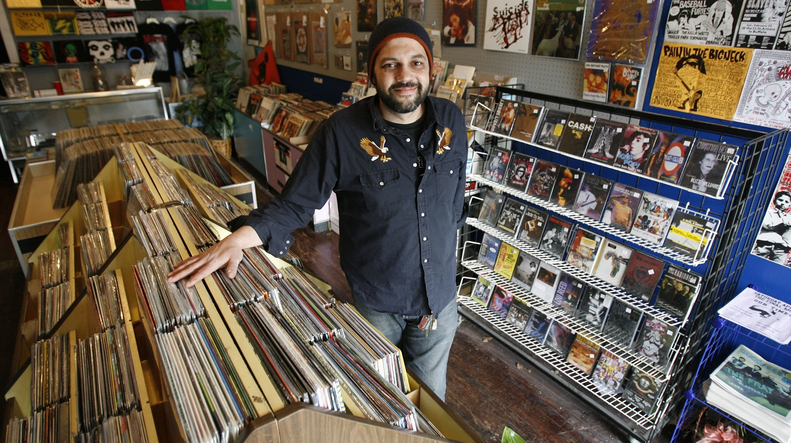 Dave Palumbo, the owner of Spiral Scratch Records, will try to find a new location. He's pictured, above, at his old Delaware Avenue store in 2009. (Sharon Cantillon/Buffalo News file photo)