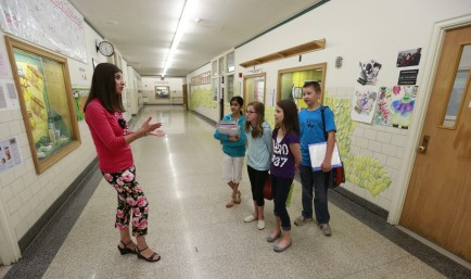 Principal Carmelina Persico talks with students at Hoover Middle School, 249 Thorncliff Road in Town of Tonawanda, N.Y., on Thursday, May 14, 2015.   (John Hickey/Buffalo News)