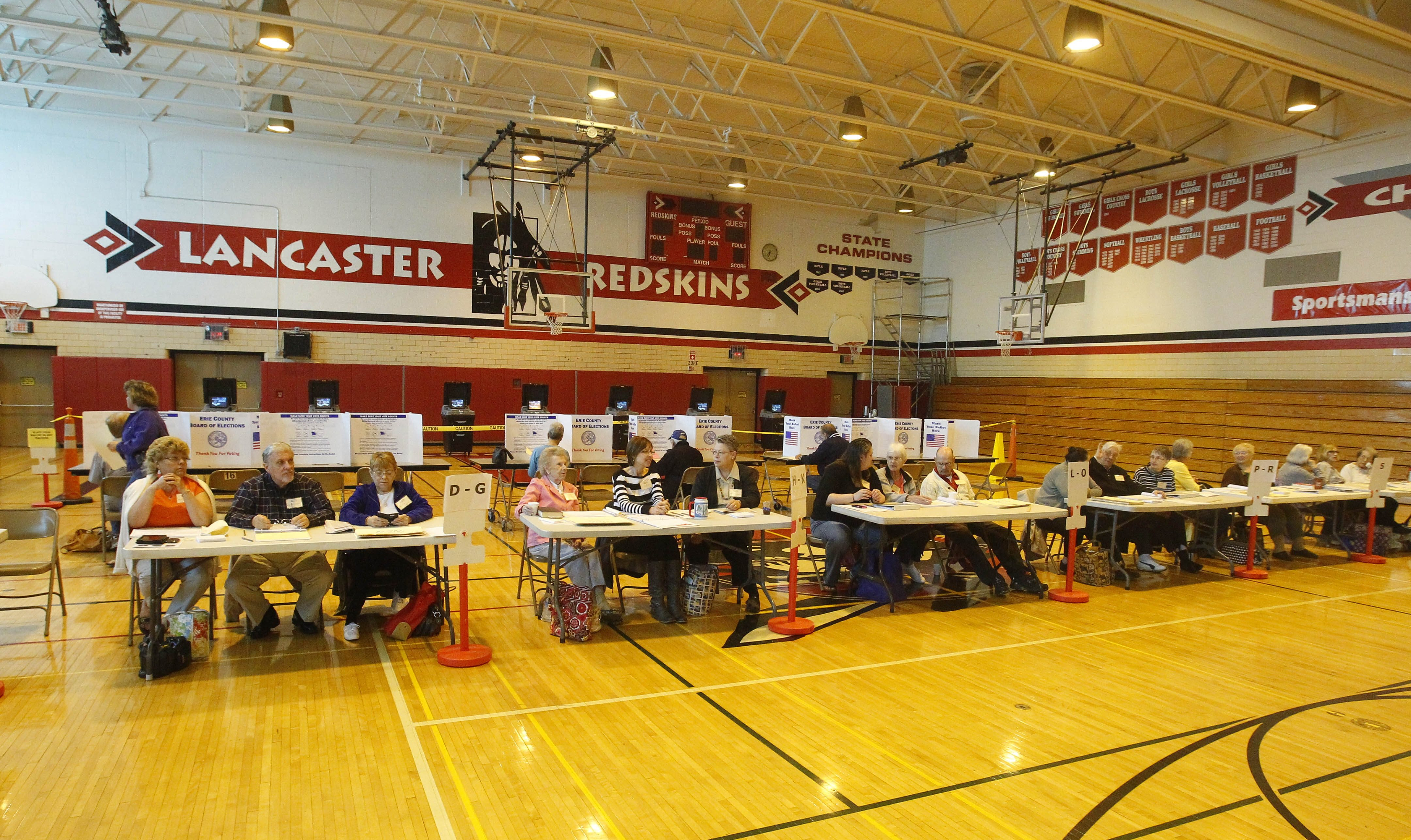 Election Inspectors at  at  Lancaster high school 1 Forton Drive in Lancaster, N.Y., for the School Budget vote on  Tuesday, May 20, 2014.  (John Hickey/Buffalo News)