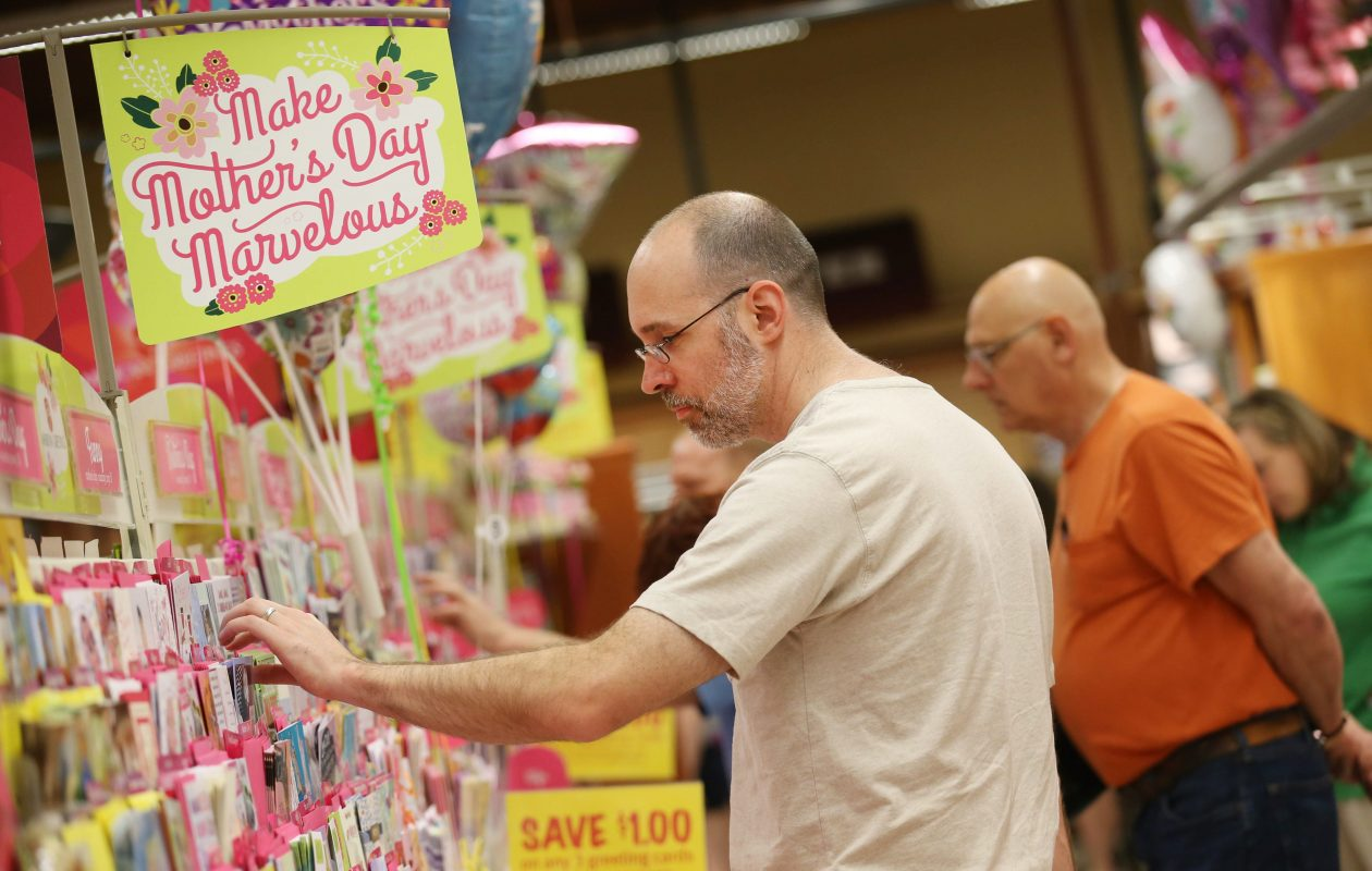 The card section at the Wegmans on McKinley Pkwy in Hamburg was very busy as last minute shoppers were buying their Mother's Day cards, Saturday, May 9, 2015.  John Snyder of Hamburg looks for a card for his wife that will be from his kids ages 5 and 8.  (Sharon Cantillon/Buffalo News)