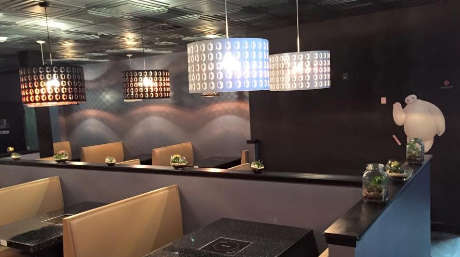 In the Boiling Point restaurants new space, tabletop heating elements keep soup simmering.