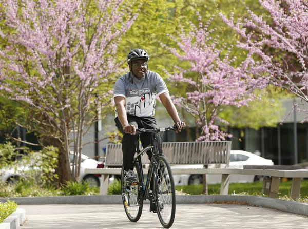 uffalo Mayor Byron Brown rides his bike on the Buffalo Niagara Medical Campus following a press conference to promote national 'Bike to Work Day,' Friday, May 15, 2015.  (Derek Gee/Buffalo News)