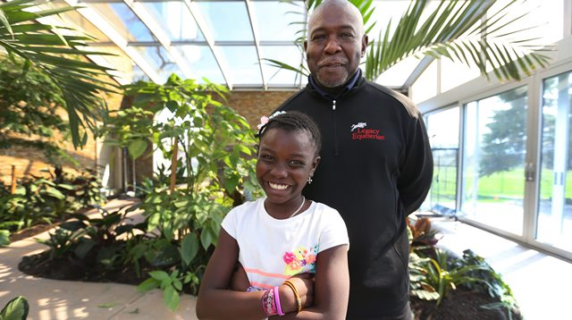 Dr. Greg Daniel and his adopted daughter Chekina at their home in East Amherst Wednesday, April 22, 2015.    (Mark Mulville/Buffalo News)