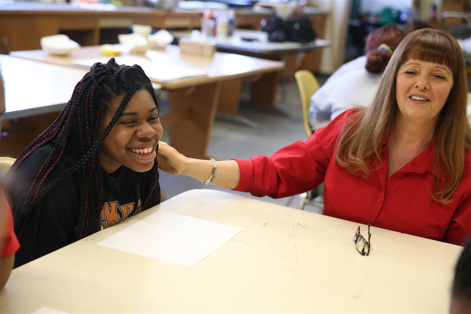 SUNY Buffalo State art education professor Lucy Andrus, right, and several of her students are teaching a group of McKinley High School students with special needs this semester. (Sharon Cantillon/Buffalo News)