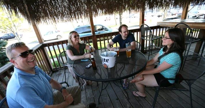Some local folks enjoy the recent warm weather at Rafferty's Irish Pub on Harlem Road in Cheektowaga. (Sharon Cantillon/Buffalo News)