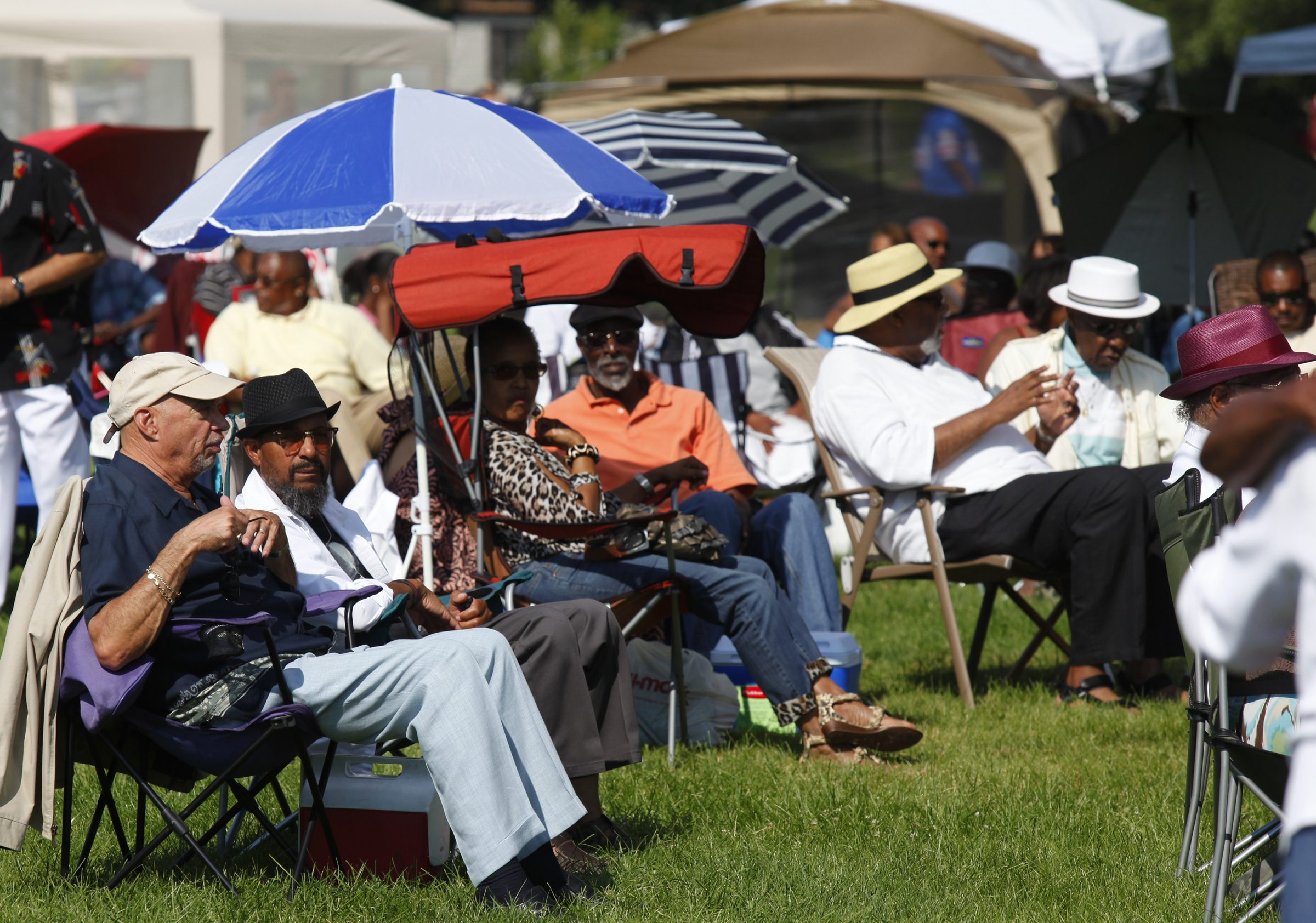 People listen to the the Sabu Adeyola band at the  annual Pine Grill Reunion at Martin Luther King Park, on Sunday, Aug. 11, 2013. Harry Scull Jr. / Buffalo News}