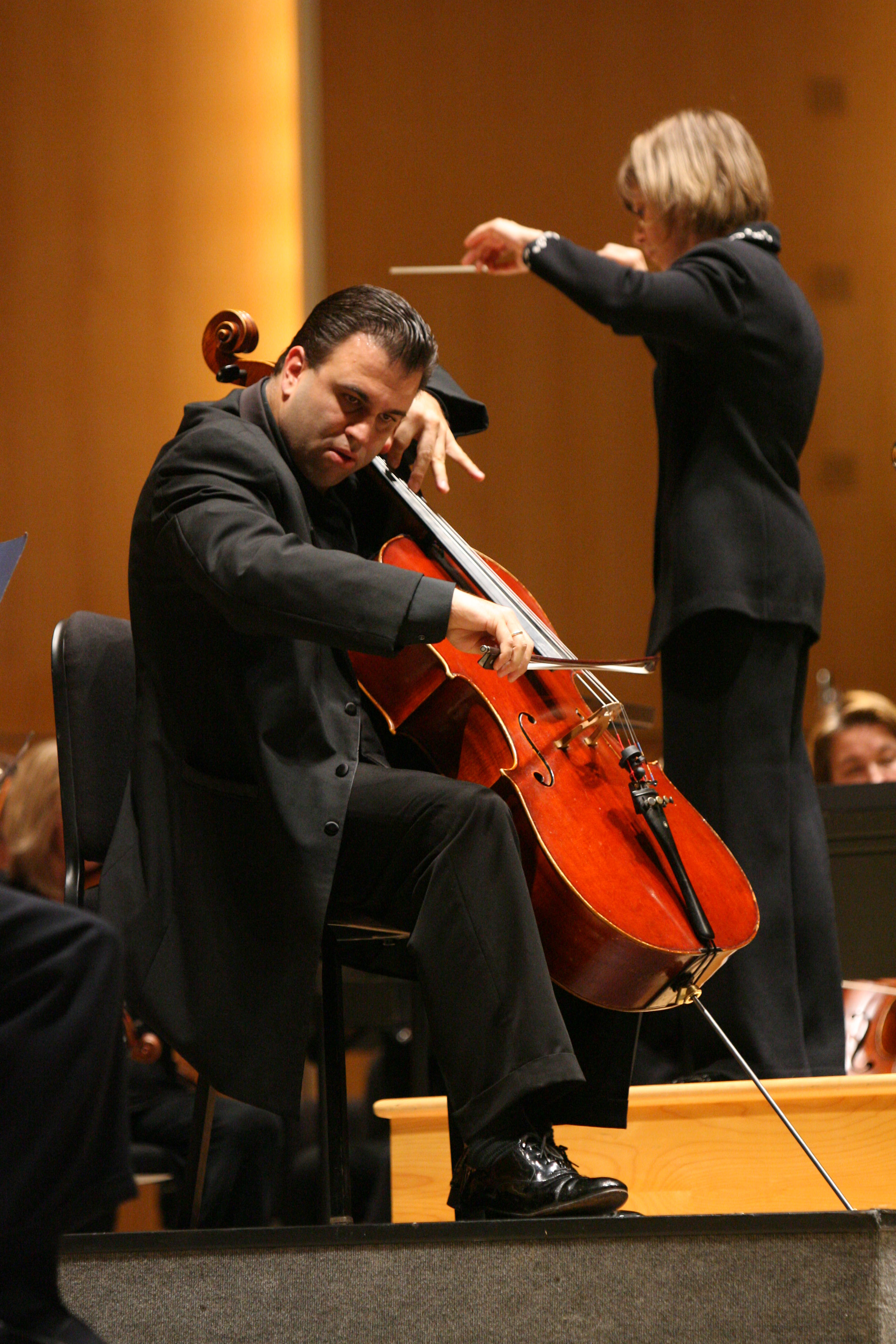 "BPO Principal Cellist Roman Mekinulov, shown in a News file photo with Music Director JoAnn Falletta, performed the world premiere of Miguel del Aguila's ""Concierto en Tango"" in May 2014 with the BPO at Kleinhans Music Hall."